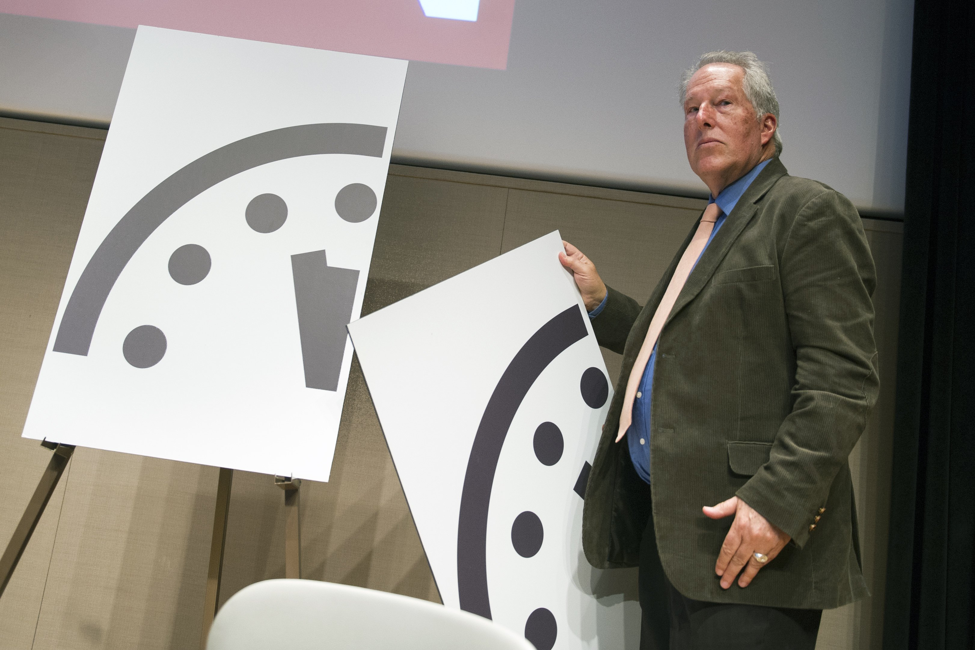 Climate scientist Richard Somerville, a member, Science and Security Board, Bulletin of the Atomic Scientists, unveils the new Doomsday Clock in Washington on Jan. 22, 2015.