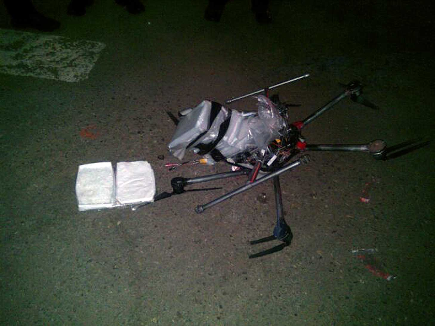 A drone loaded with packages containing methamphetamine lies on the ground after it crashed into a supermarket parking lot in the Mexican city of Tijuana on Jan. 20, 2015