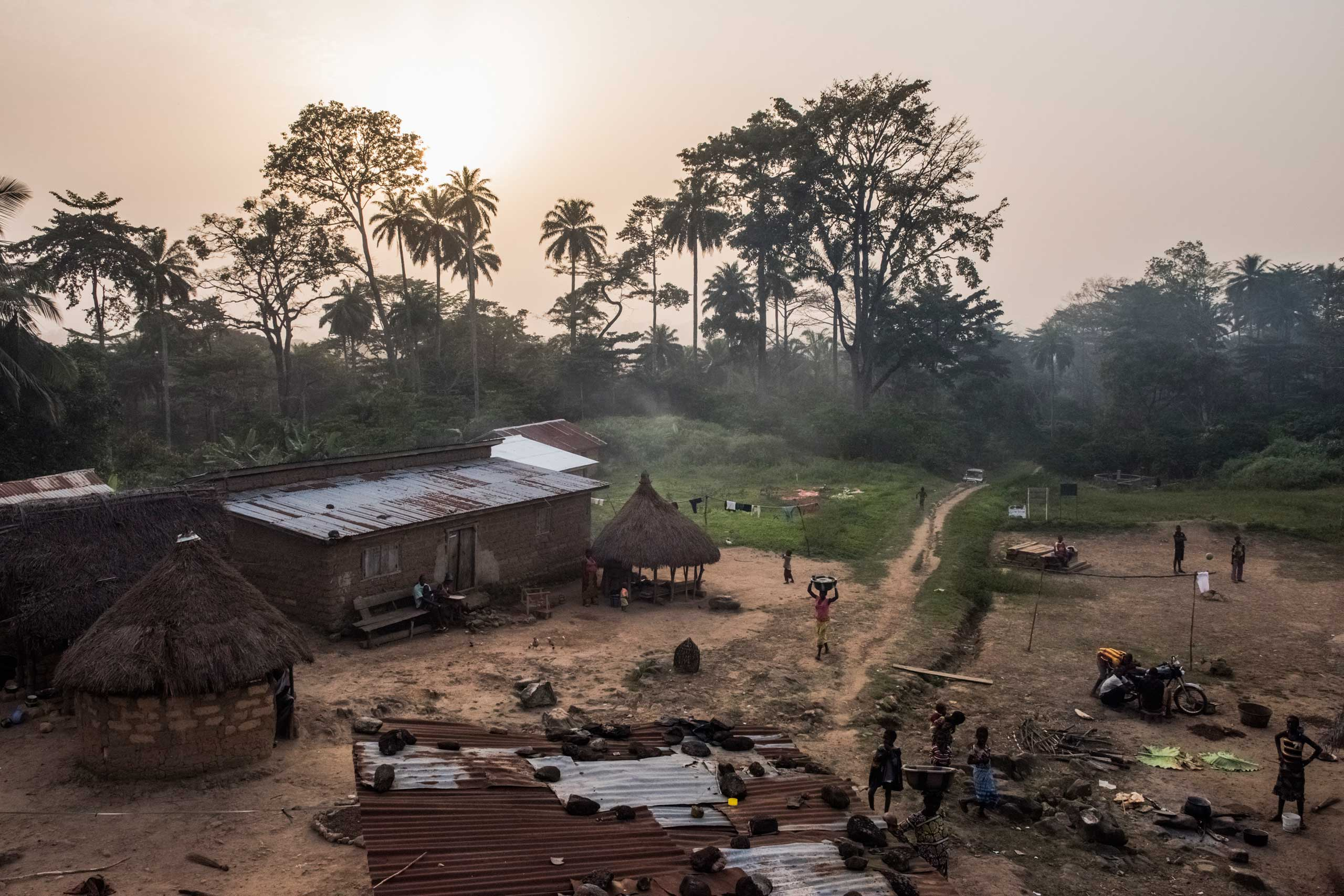 The New York Times: How Ebola Roared BackResidents set in for the evening in the village of Meliandou, where a 1-year-old boy named Emile Ouamouno came down with symptoms consistent with Ebola and died in late Dec. 2013, in Guinea, Dec. 14, 2014. Emile is considered Patient Zero in the current outbreak across Guinea, Sierra Leone and Liberia.
