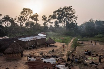 Residents set in for the evening in the village of Meliandou, Guinea, where a 1-year-old boy named Emile Ouamouno came down with symptoms consistent with Ebola and died in late December 2013.