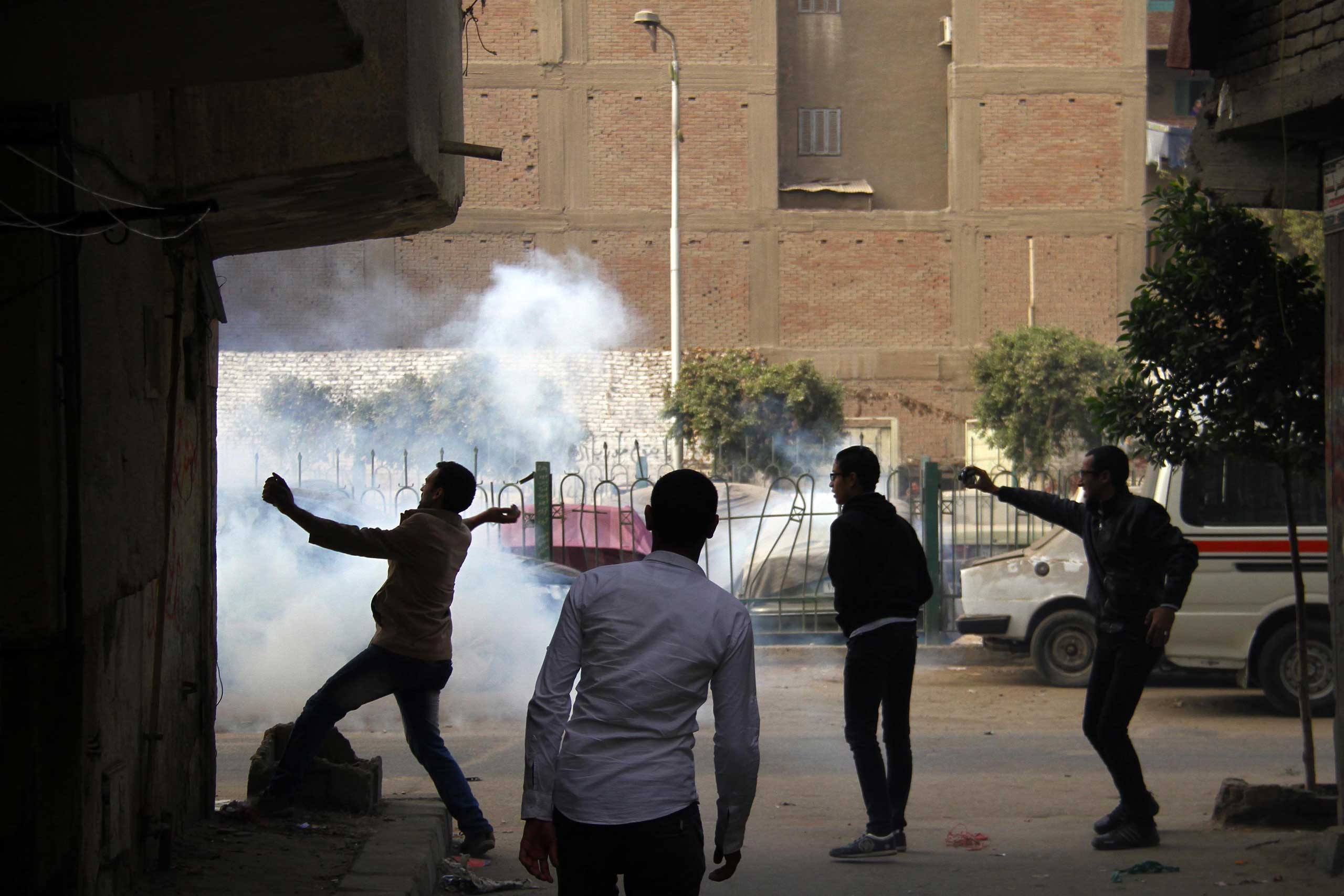 Supporters of Egypt's ousted President Mohamed Morsi are seen in clashes with the police during a demonstration in the district of Matariyah, eastern Cairo on Jan. 25, 2015,