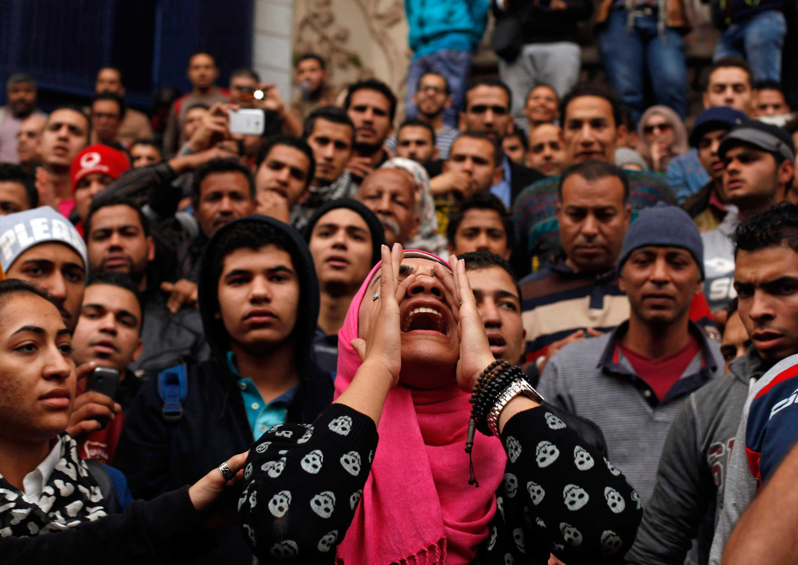 An anti-government protester chants slogans during a protest in front of the journalists' syndicate in Cairo, Jan. 25, 2015.
