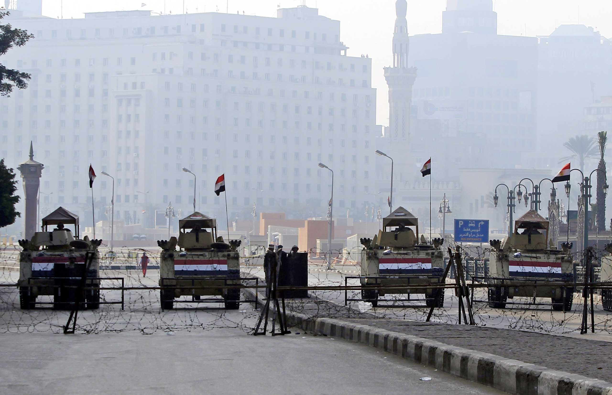Egyptian army APCs block an entrance to Tahrir Square, Cairo, Jan. 25, 2015.