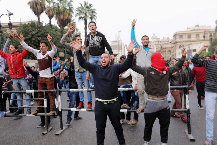 Anti-government protesters shout during demonstrations in downtown Cairo, Jan. 25, 2015.