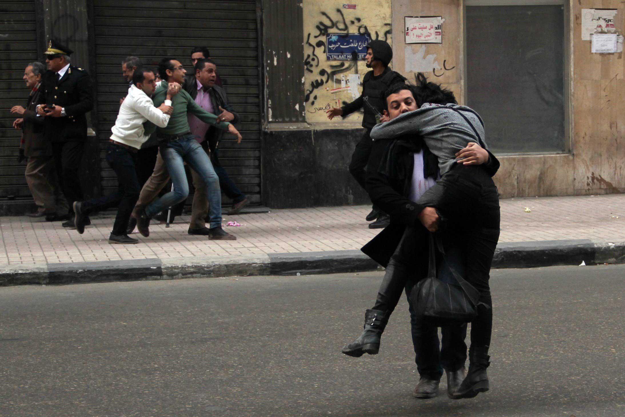 Shaima al-Sabbagh is carried away after being shot in Cairo, Jan. 24, 2015.