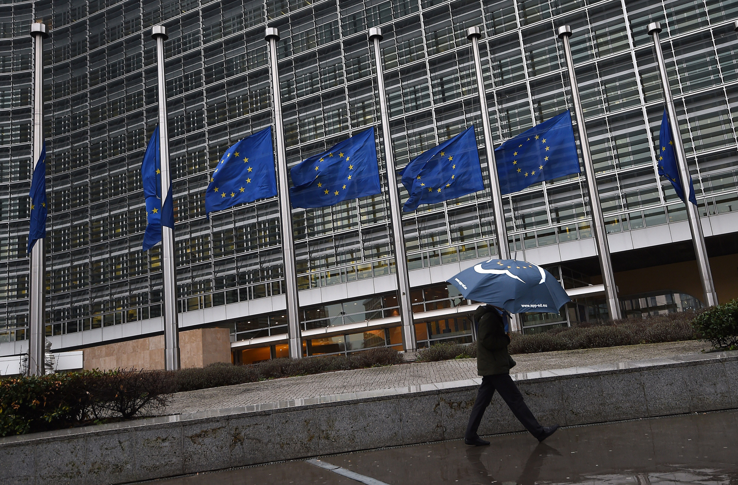 European Union flags fly at half-mast at the European Parliament in Brussels on Jan. 8, 2015, following the attack against French satirical weekly Charlie Hebdo