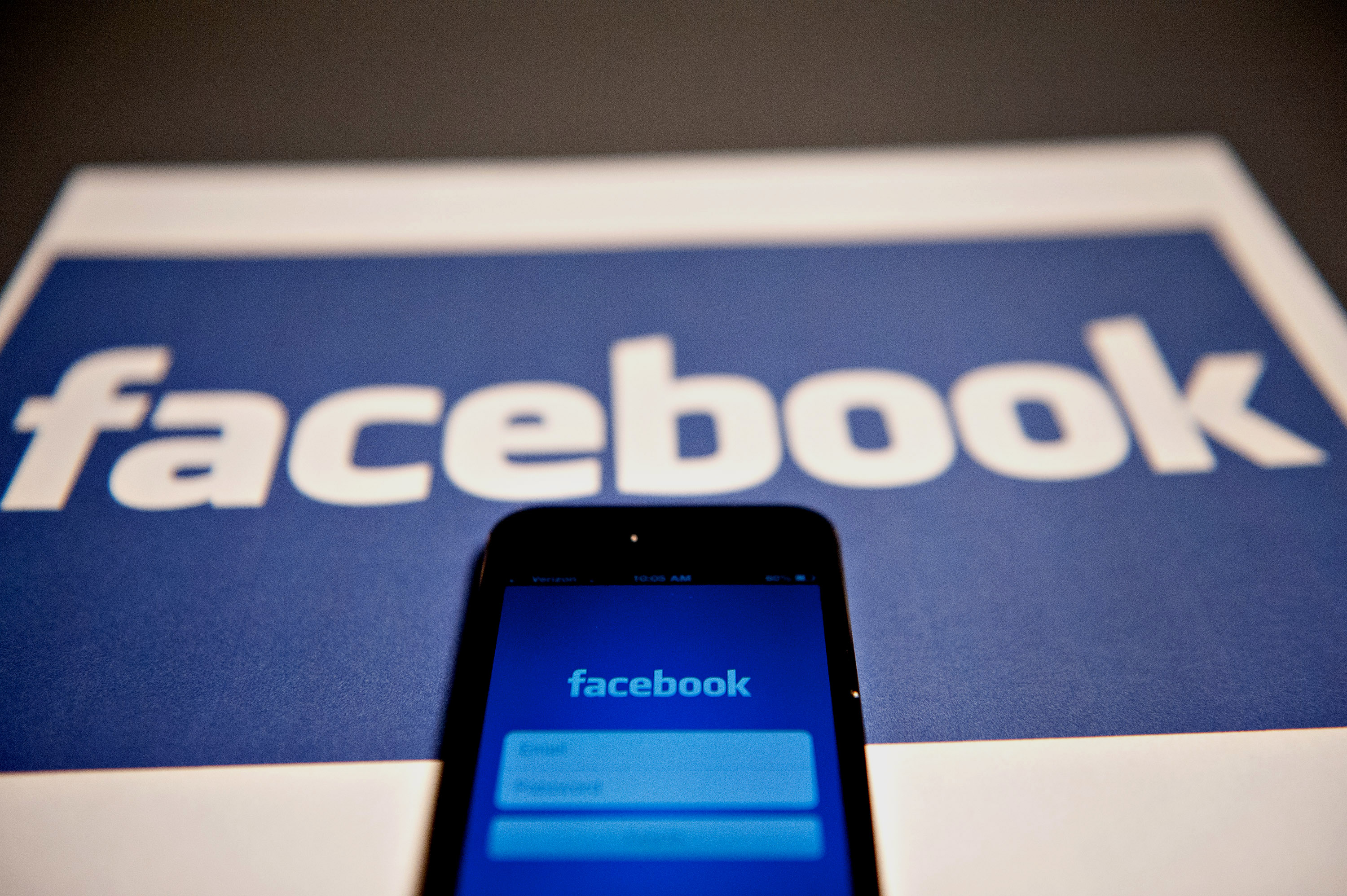 The login page for the Facebook Inc. mobile application is displayed on an Apple Inc. iPhone 5.