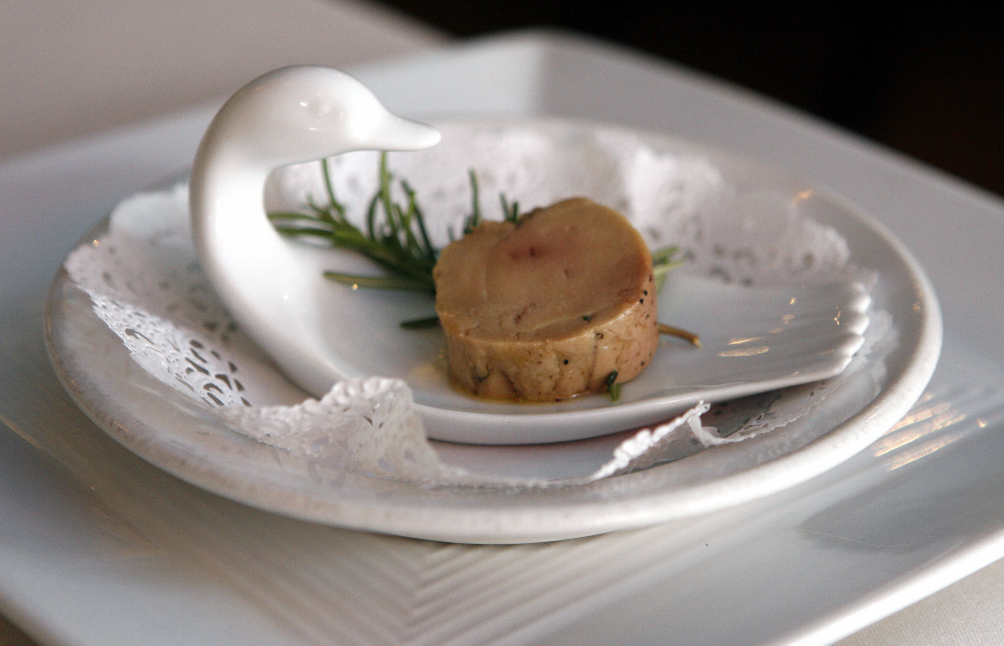 In this Aug. 9, 2006, file photo, a serving of salt-cured fresh foie gras with herbs is displayed at chef Didier Durand's Cyrano's Bistrot & Wine Bar in Chicago