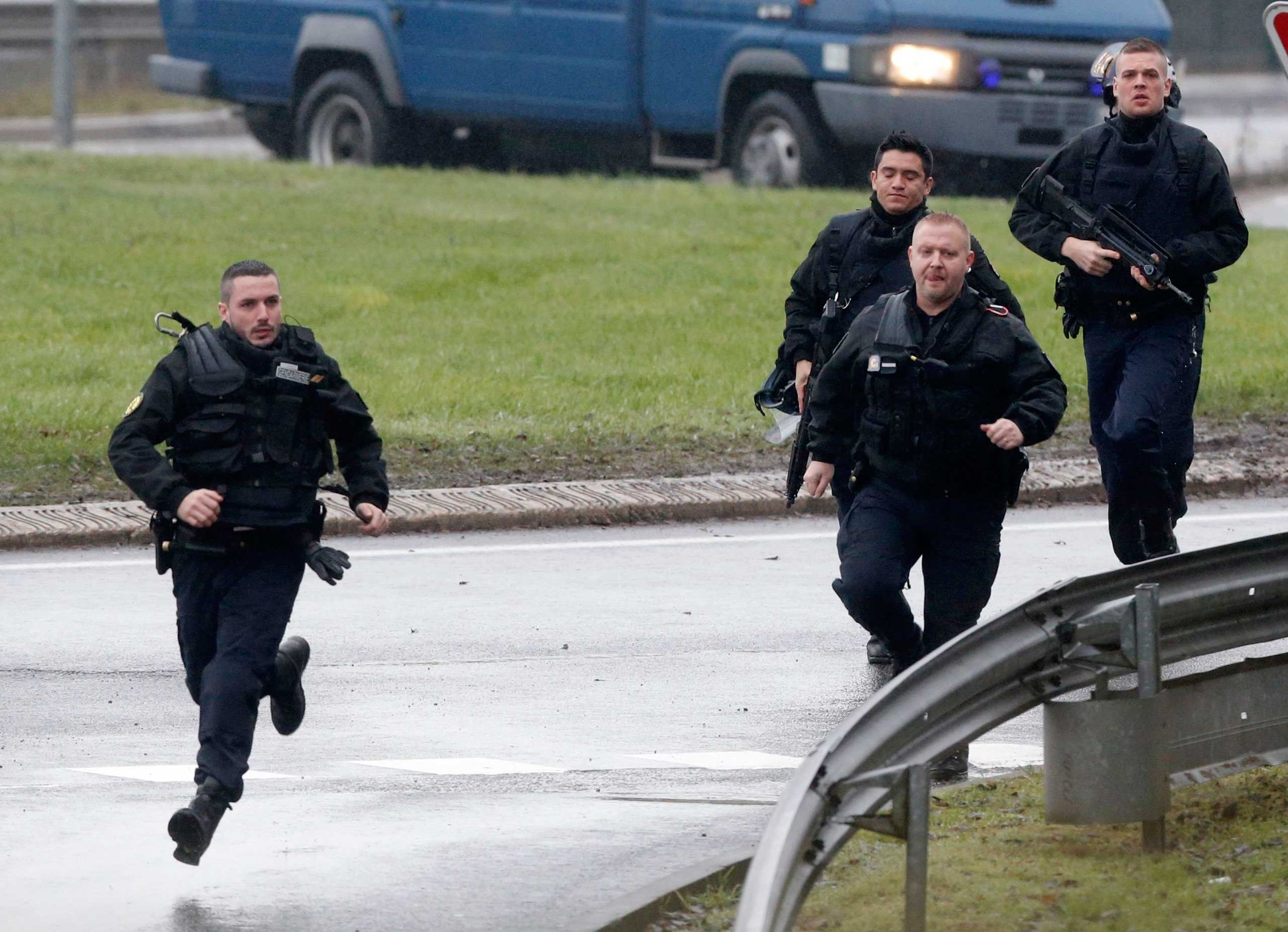 Members of the French gendarmerie intervention forces arrive at the scene of a hostage taking at an industrial zone in Dammartin-en-Goele, northeast of Paris, Jan. 9, 2015.
