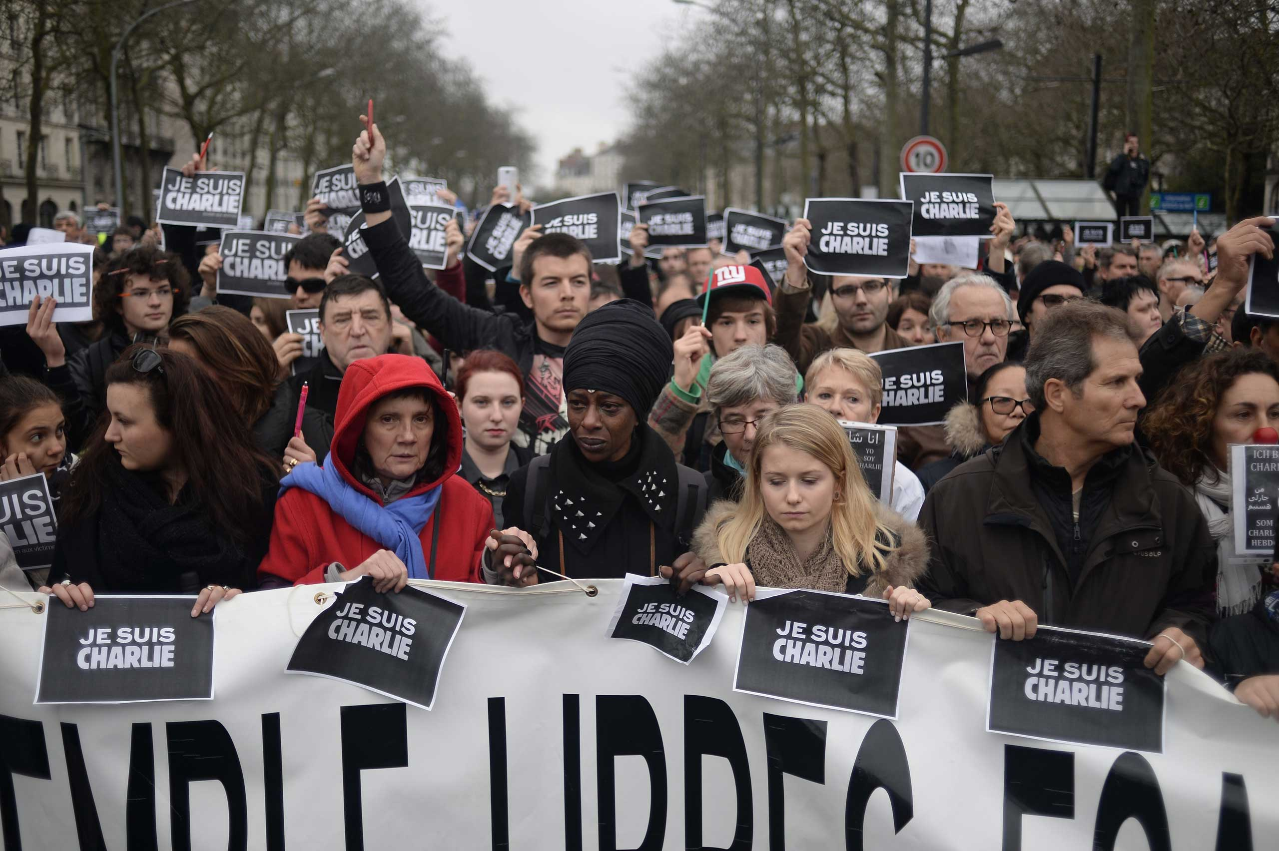 "Demonstrators hold signs that reads ""Je suis Charlie"" during a rally in Nantes on Jan. 10, 2015,."