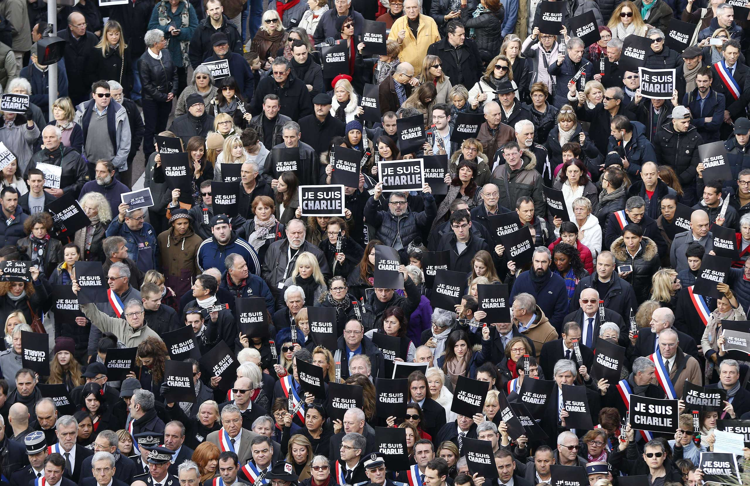 "Tens of thousands of people some holding up signs that read, ""Je suis Charlie"" march in Nice, on Jan. 10, 2015."