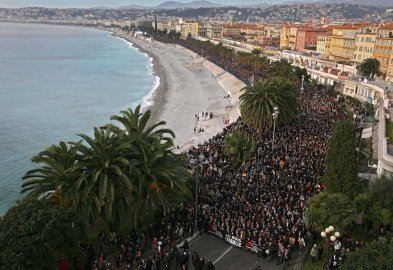 People take part in a silent procession for victims of the shooting at the satirical newspaper Charlie Hebdo, Jan. 10, 2015, in Nice, southeastern France.