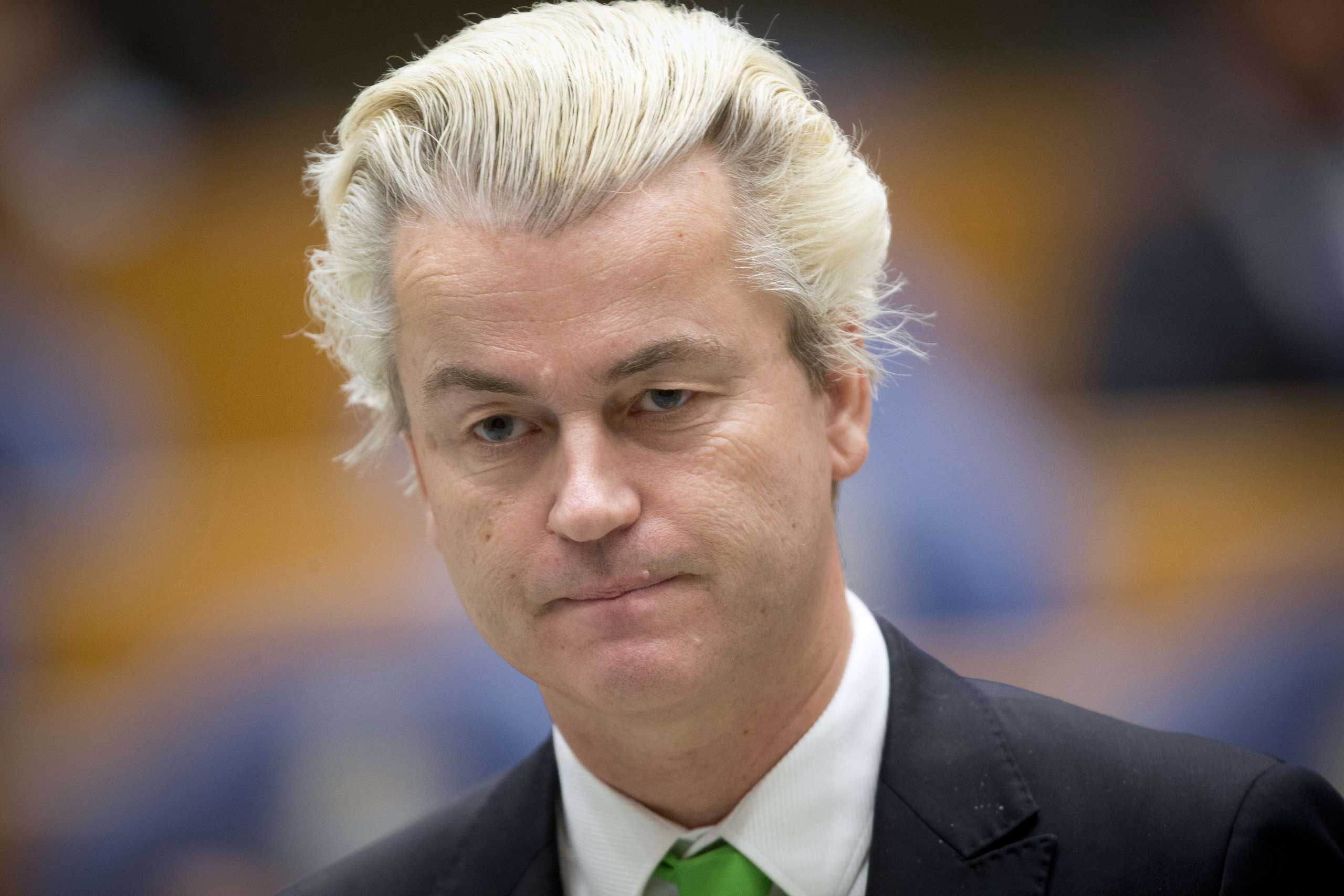 Dutch far-right politician Geert Wilders of the Party for Freedom stands at the parliamentary building in the Hague on Dec. 18, 2014