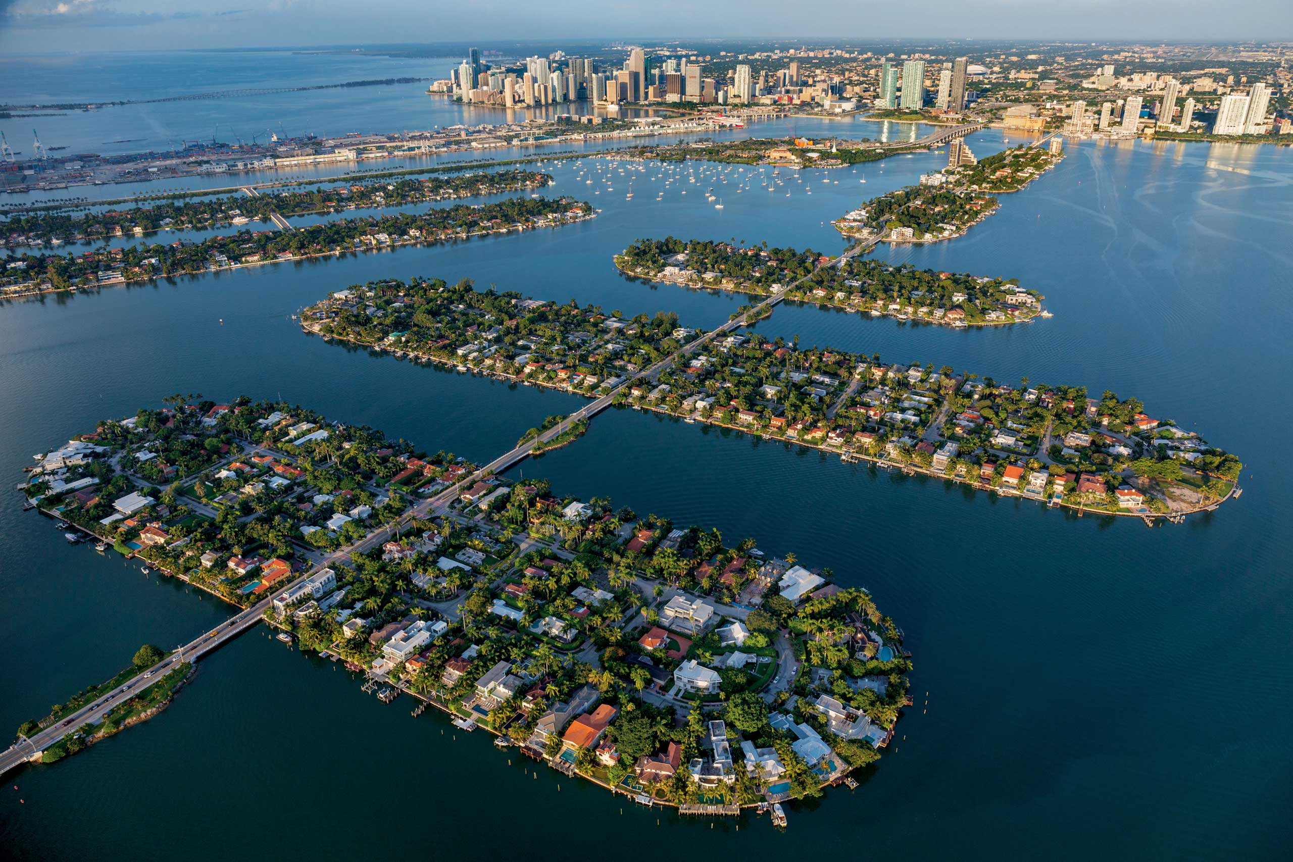 From the February issue of National Geographic magazine: Treading WatersIn Biscayne Bay the Venetian Causeway connects Miami Beach to Miami (in the distance) by way of the six man-made Venetian Islands, which epitomize waterfront living.