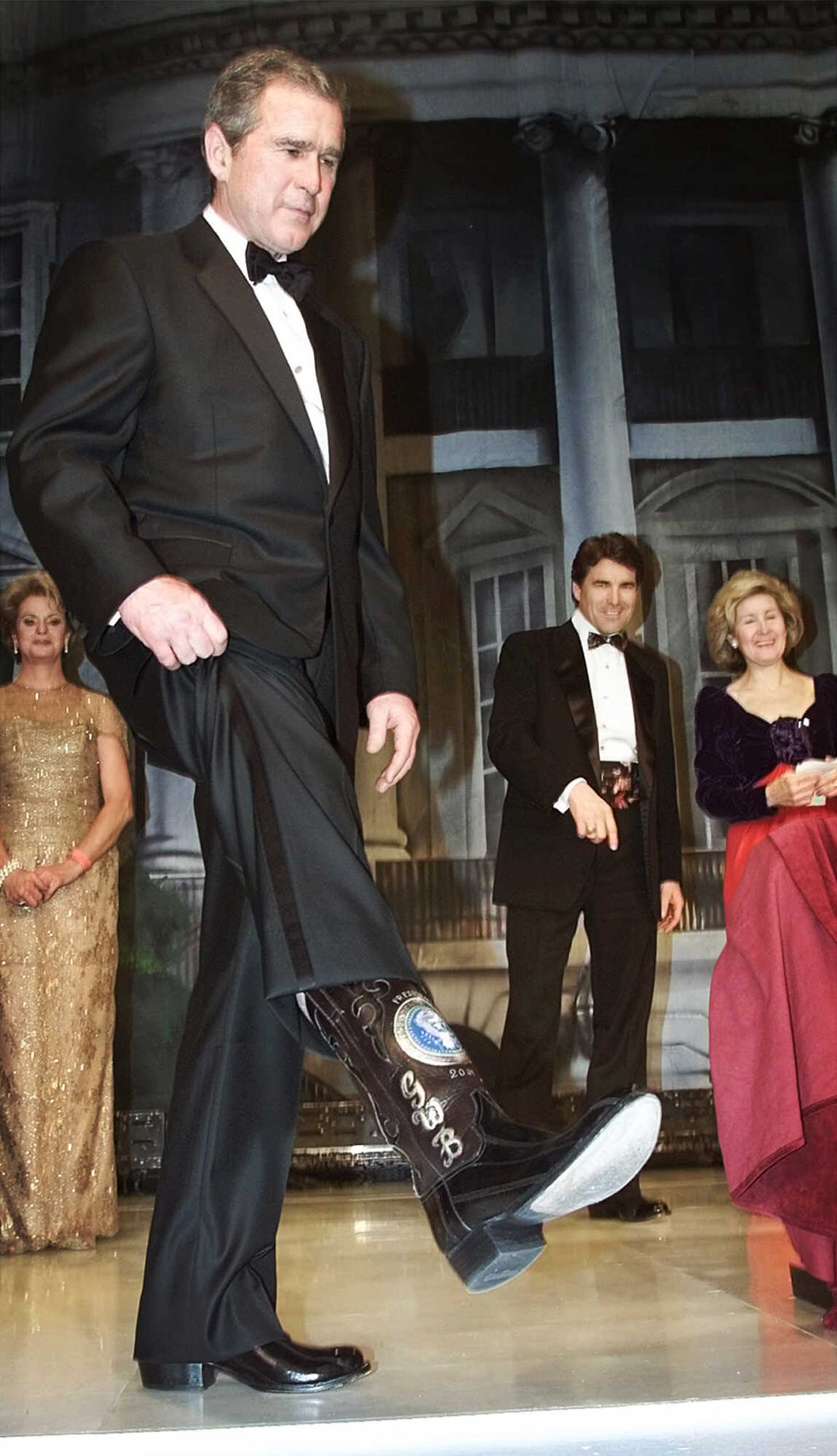 President George W. Bush, showing off boots with the presidential seal here at his inauguration, furthered the trend.