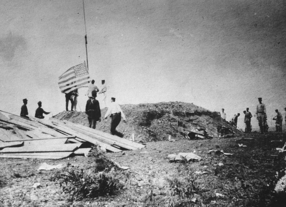US Marines raising the American Flag over Guantanamo Bay in 1898