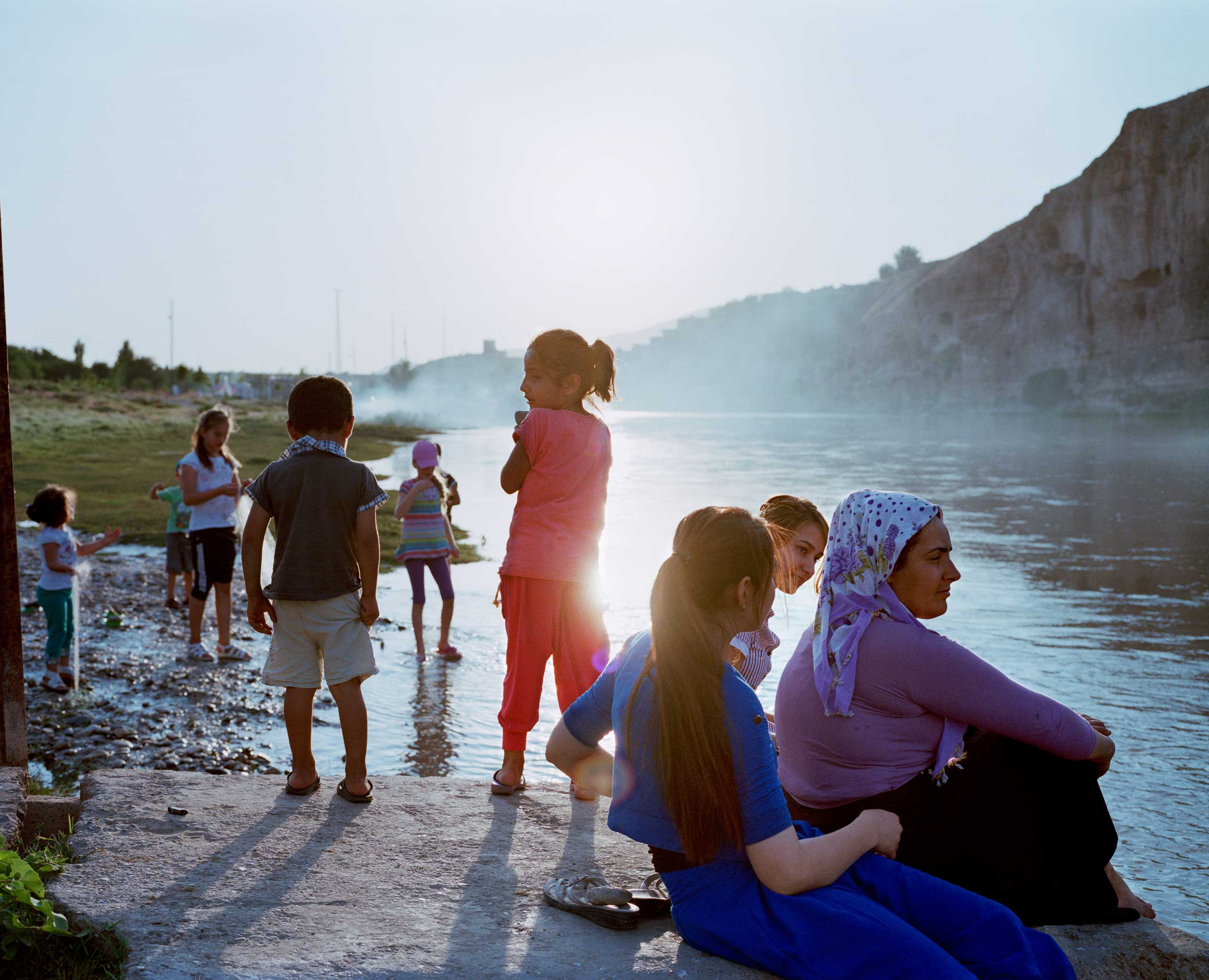 Children play by the banks of the Tigris River. Hasankeyf, Turkey.