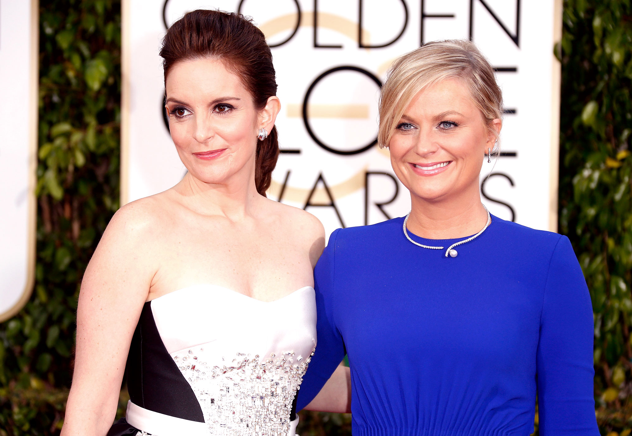 Hosts Tina Fey and Amy Poehler attend the 72nd Annual Golden Globe Awards at The Beverly Hilton Hotel on Jan. 11, 2015 in Beverly Hills, Calif.