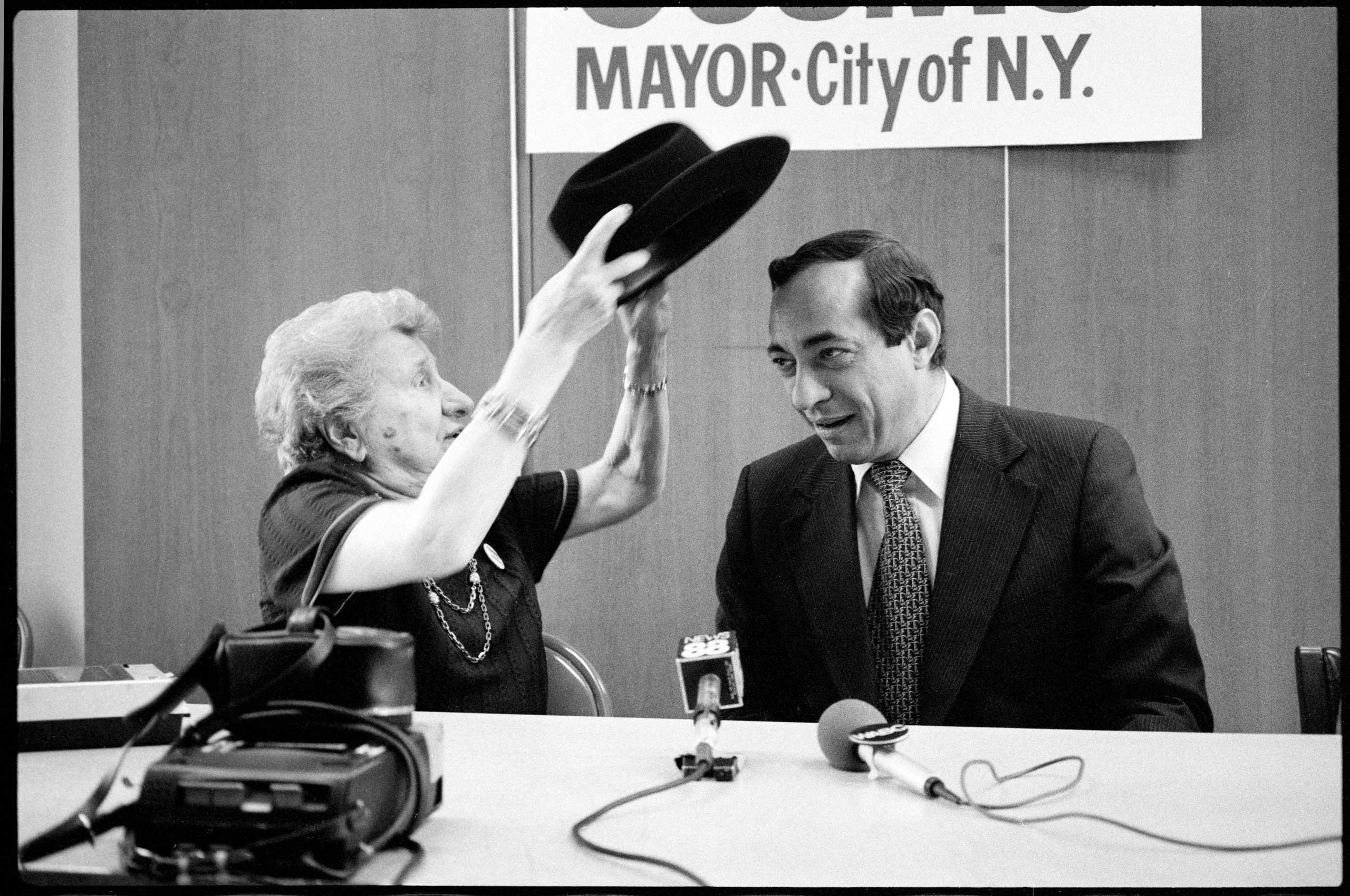 Mrs. Marie LaGuardia endorsed Mario Cuomo's candidacy for Mayor, presenting him with one of Mayor Fiorello LaGuardia's famous hats for good luck, at Cuomo's Times Square headquarters in New York City on Oct. 25, 1977.
