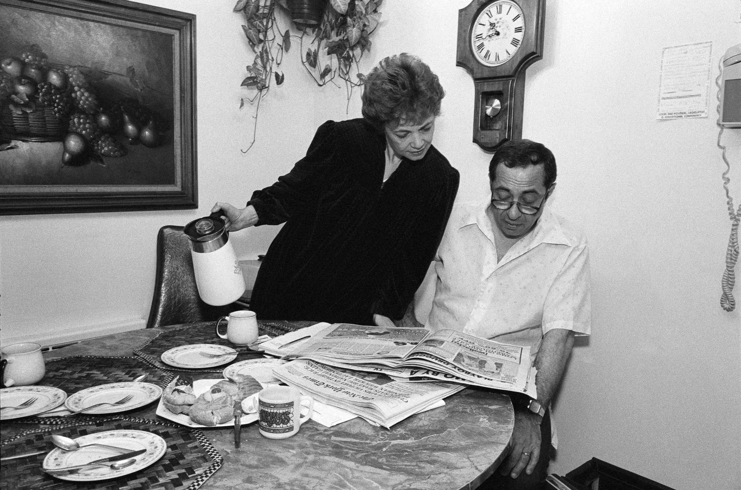 Governor-elect Mario Cuomo reads the morning papers with his wife, Matilda, at their home in the Queens borough of New York City on Nov. 3, 1982.
