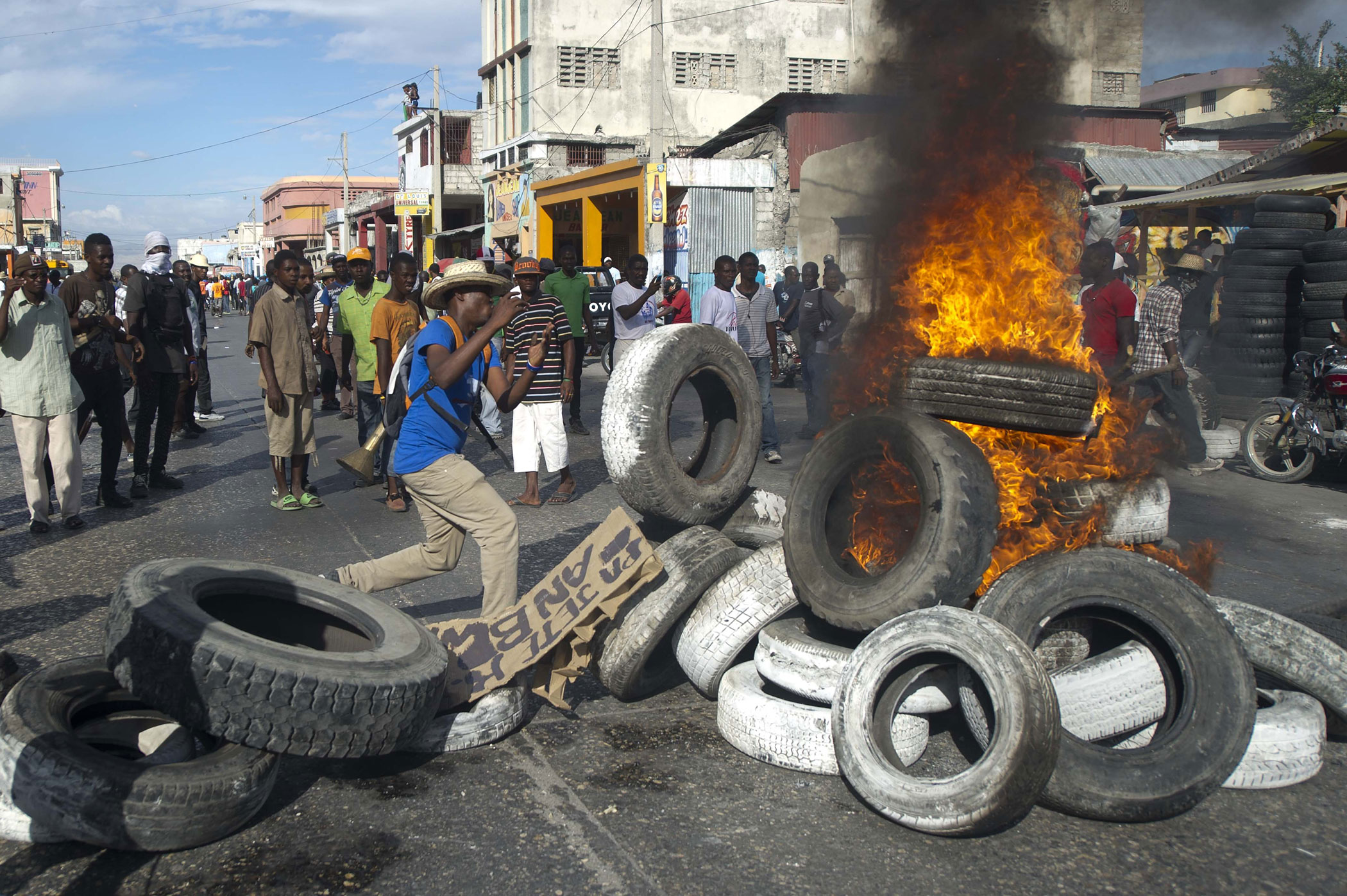 Protesters burn tires during a march against the government of Haitian President Michel Martelly in Port-au-Prince, Haiti on Jan. 11, 2015.