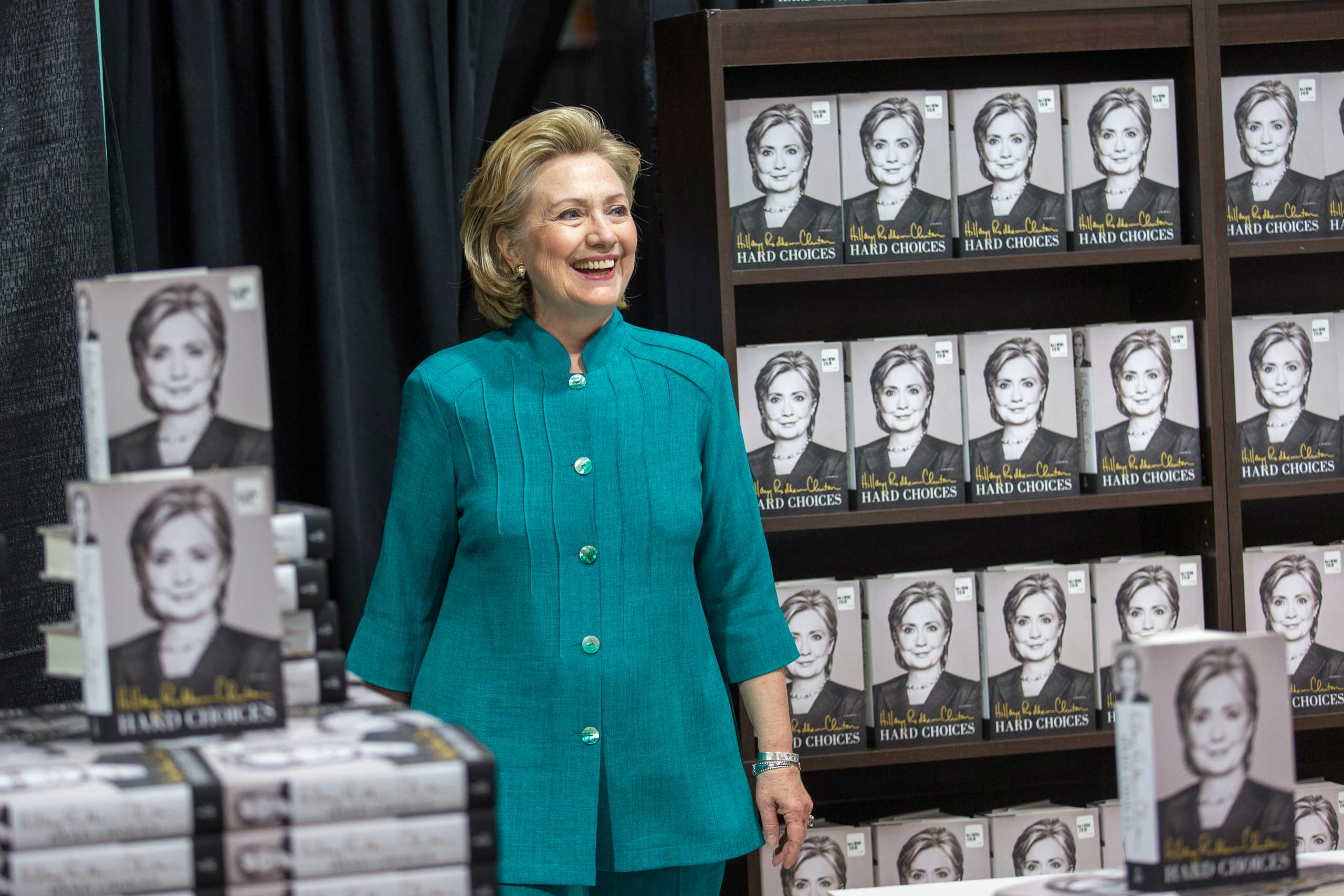 "<b>Author:</b> Clinton attends a signing memoir, ""Hard Choices,"" at a Costco in Arlington, Va., on June 14, 2014."