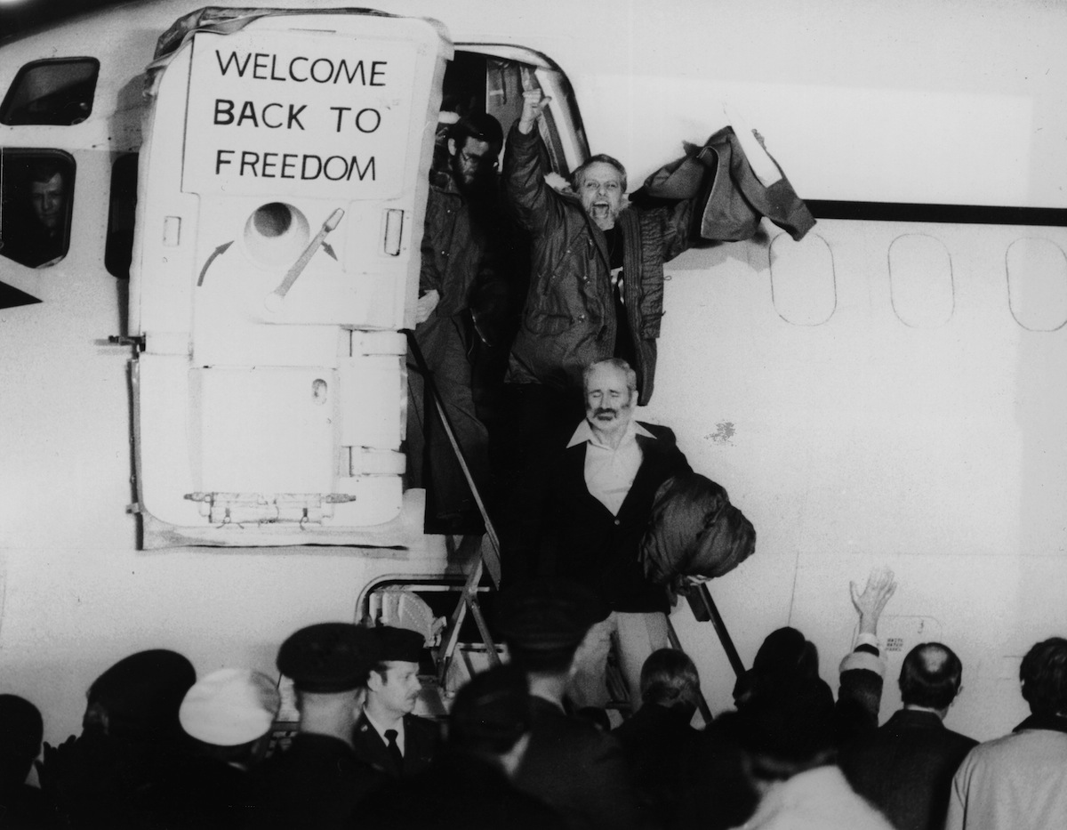 United States hostages departing an airplane on their return from Iran after being held for 444 days, in January of 1981
