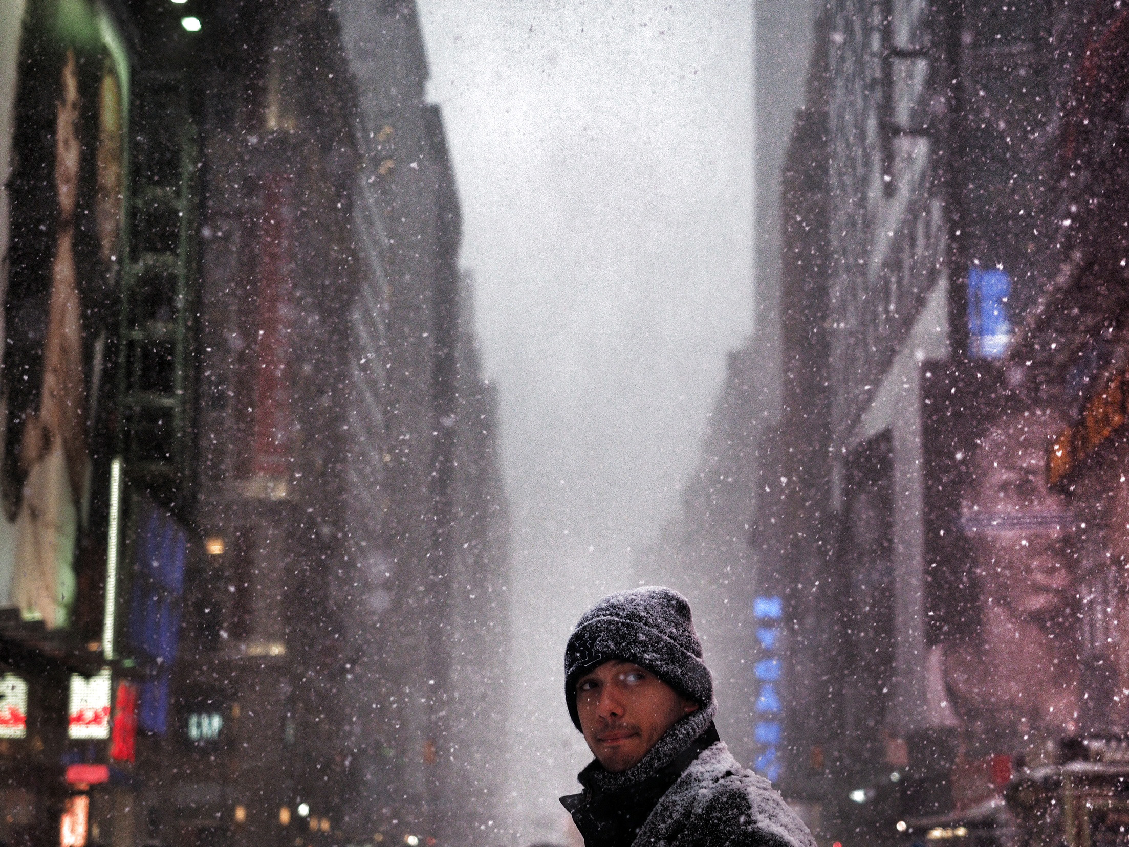 A man walks through the middle of a snow storm in Times Square, New York City on Jan. 26, 2015.