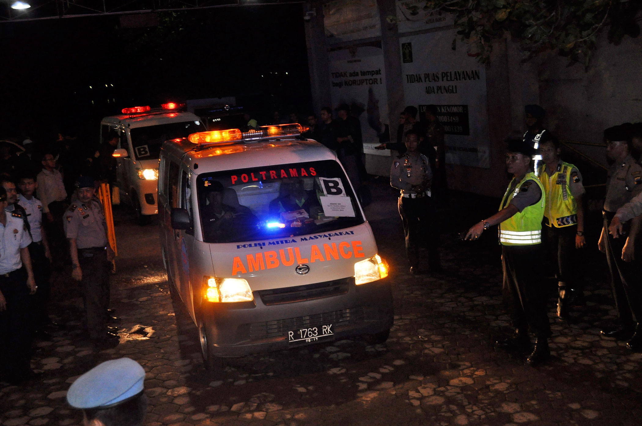 Ambulances carrying the bodies of drug convicts arrive at Wijayapura port in Cilacap, Indonesia, Jan. 18, 2015.