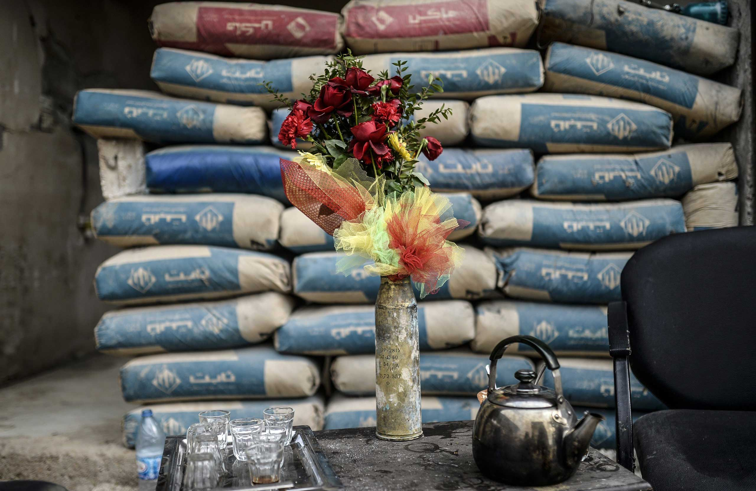A shell is used as a vase in the Syrian border town of Kobani on Jan. 28, 2015.
