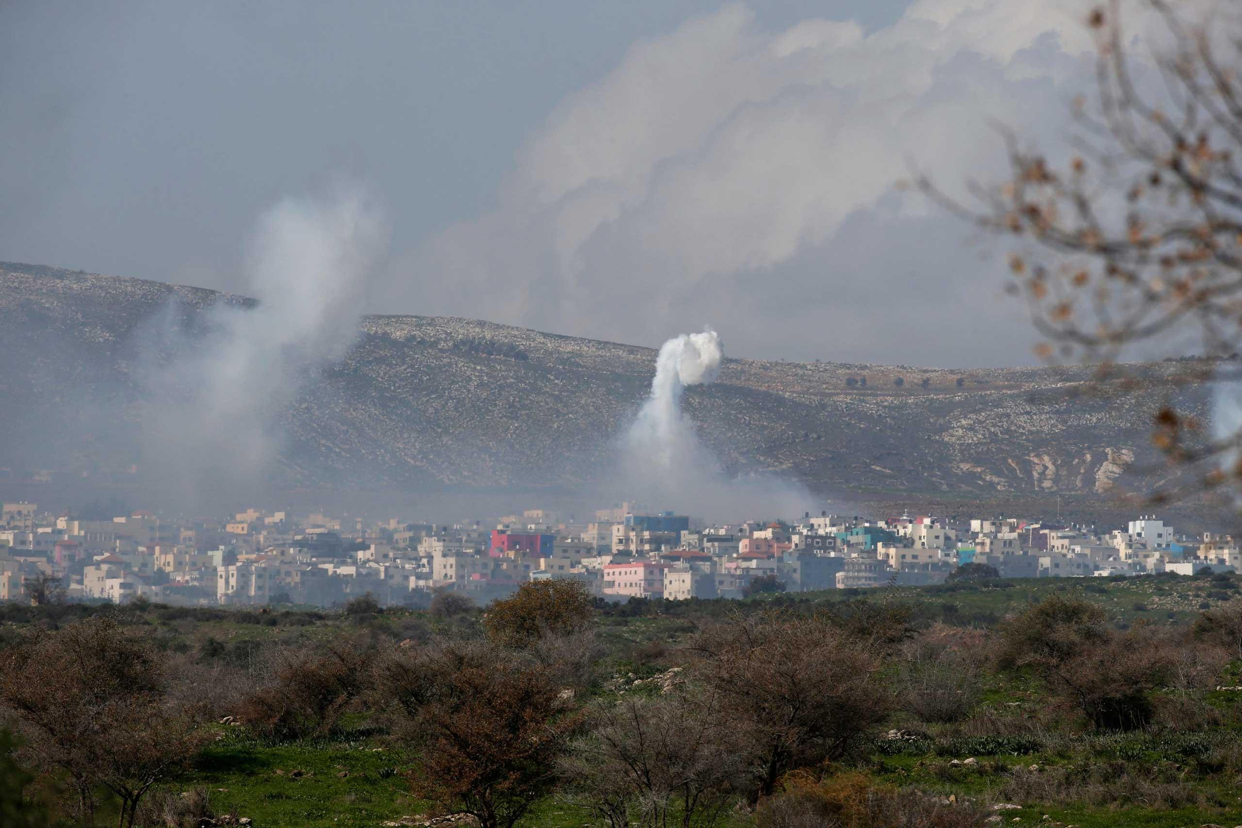 Smoke rises after an explosion in the Lebanese village of Ghajar on the Israeli-Lebanese border Jan. 28, 2015.