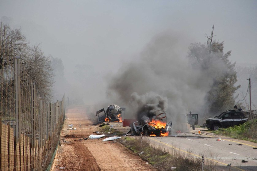 Burning vehicles are seen near the village of Ghajar on Israel's border with Lebanon, Jan. 28, 2015.