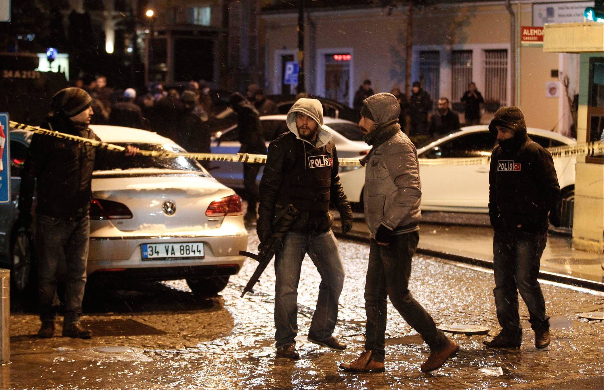 Police officers stand guard at the scene of a bomb blast in Istanbul, Turkey on Jan. 6, 2015.