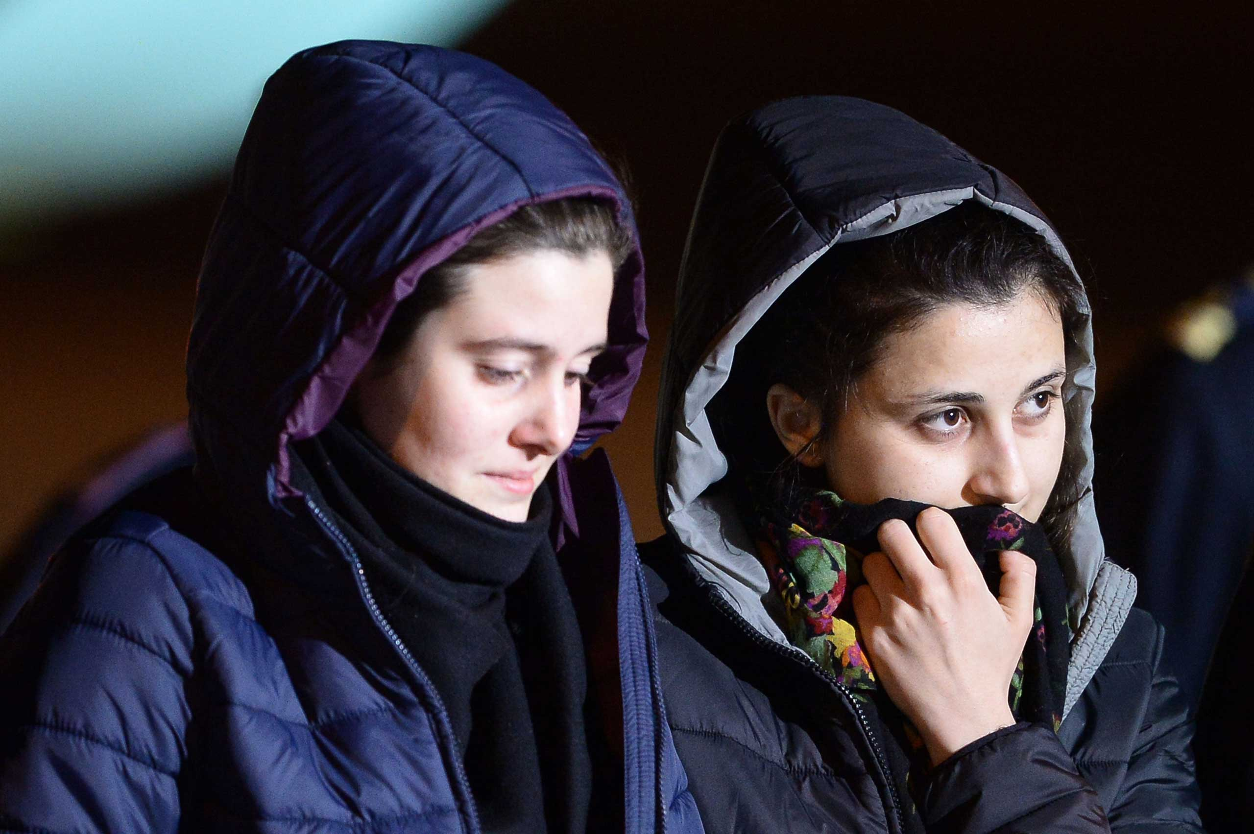 Italian aid workers abducted in Syria last summer, Greta Ramelli (L) and Vanessa Marzullo arrive at Ciampino airport in Rome early on Jan. 16, 2015.