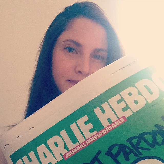 Journalist Clélie Mathias posted this photo of herself holding the new issue of Charlie Hebdo