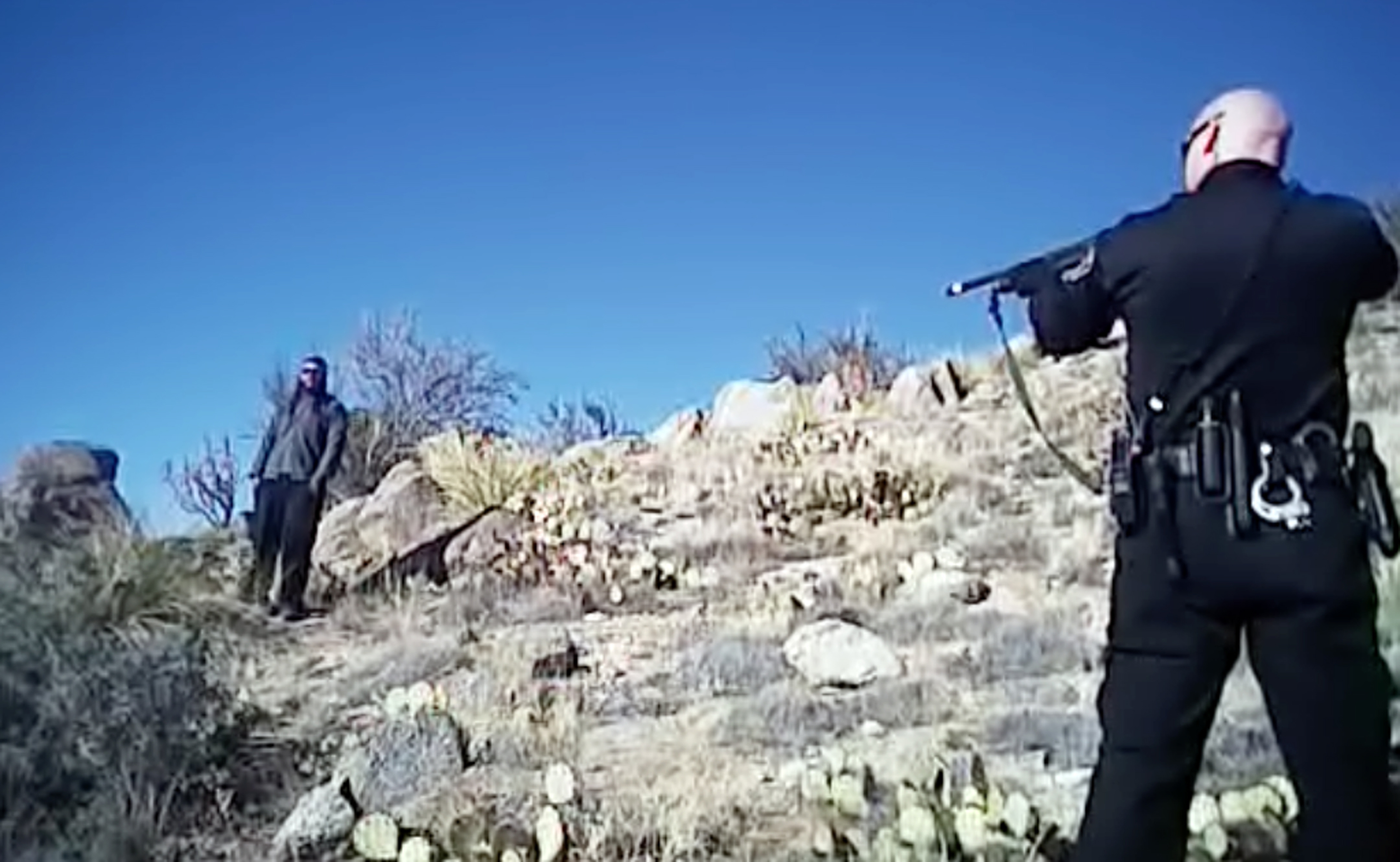 In this photo taken from a video on March 16, 2014 James Boyd is shown during a standoff with officers in the Sandia foothills in Albuquerque, N.M., before police fatally shot him.