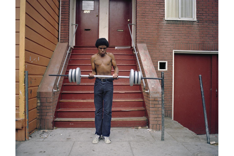 Boy lifting weights, Langton Street