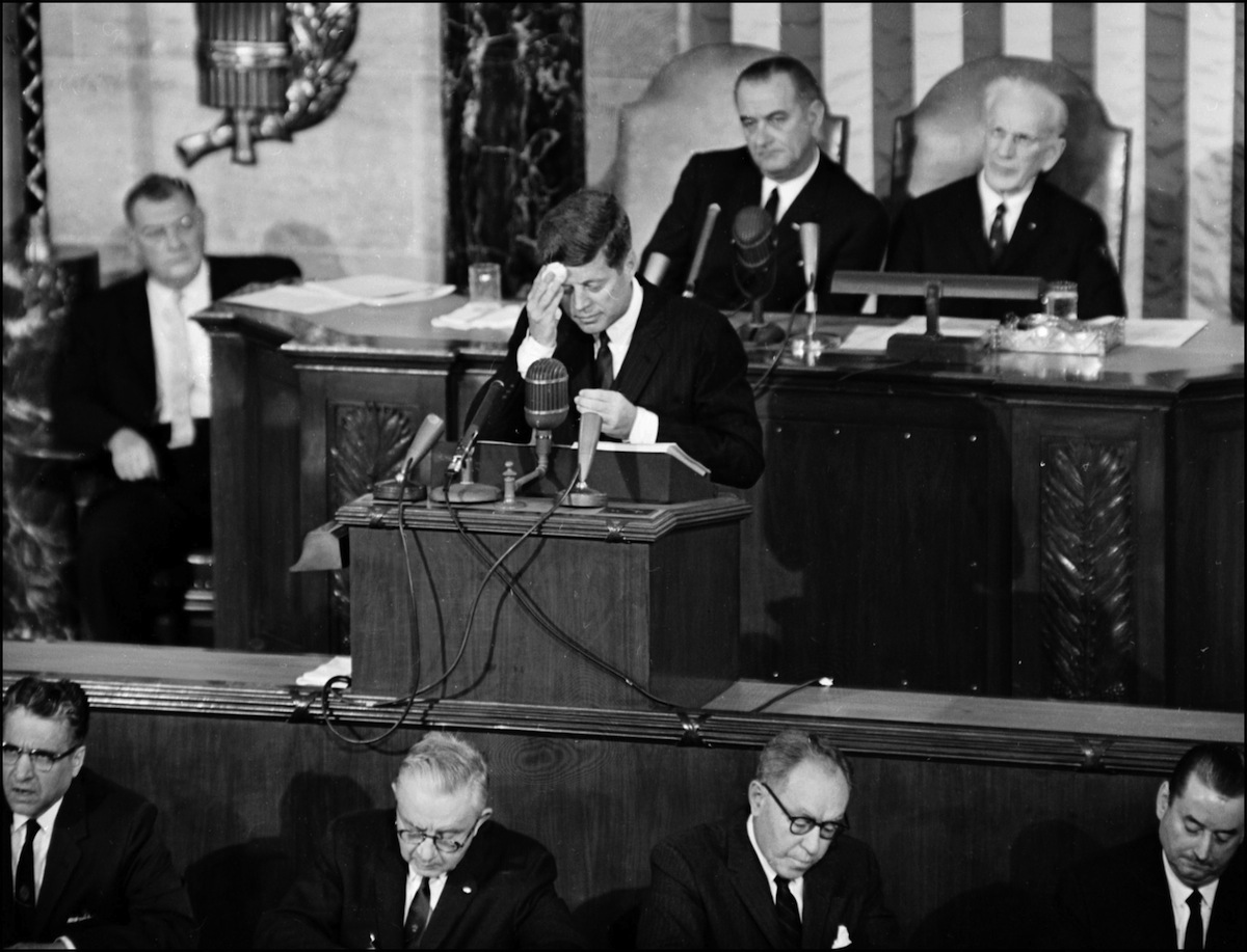 President John F. Kennedy wipes his forehead as he delivers the State of the Union address before Congress in Washington, DC, in January 1963