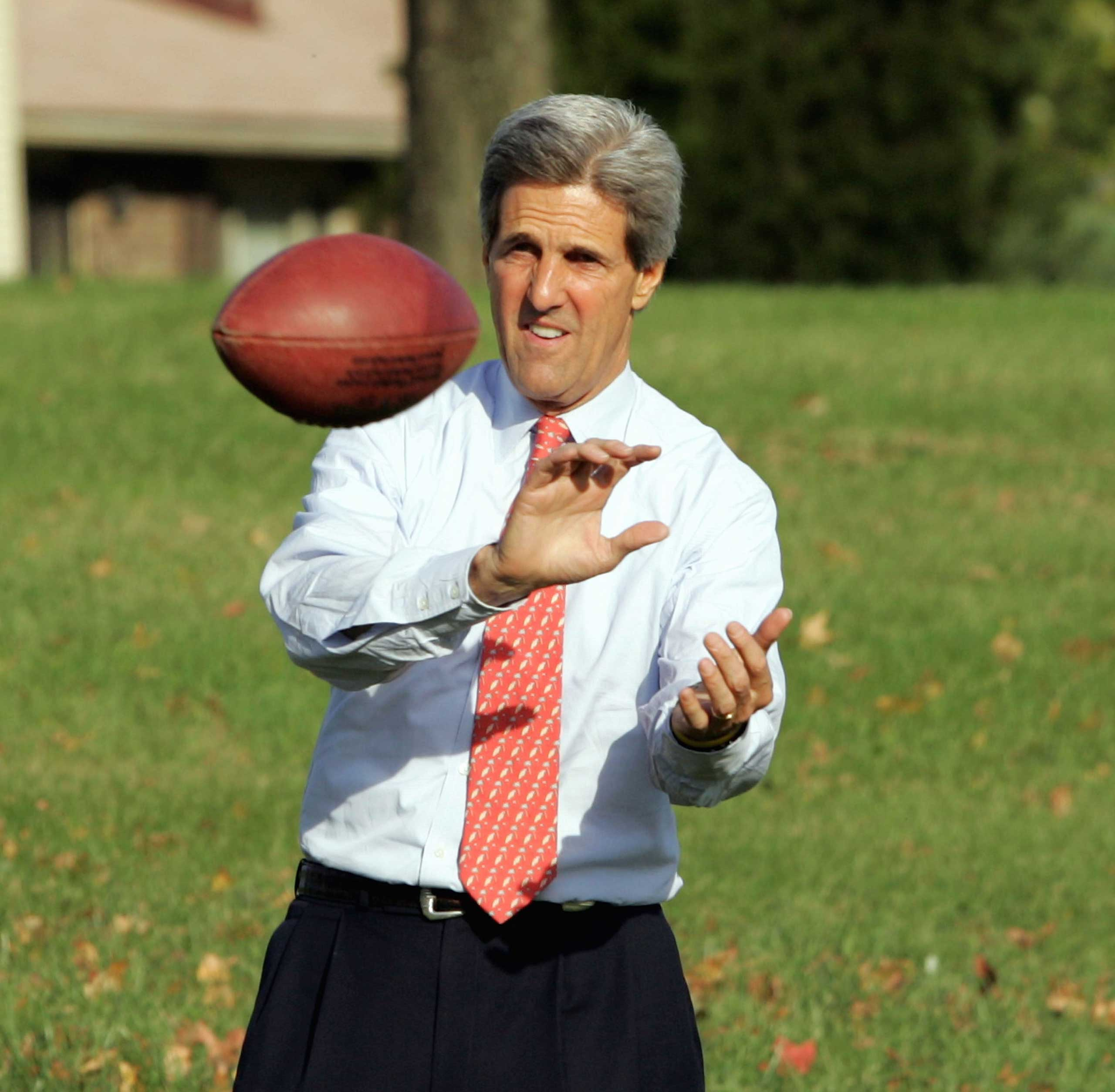 Democratic presidential candidate John Kerry (D-MA) plays football with his staff in Dayton, Ohio on Oct. 31, 2004.