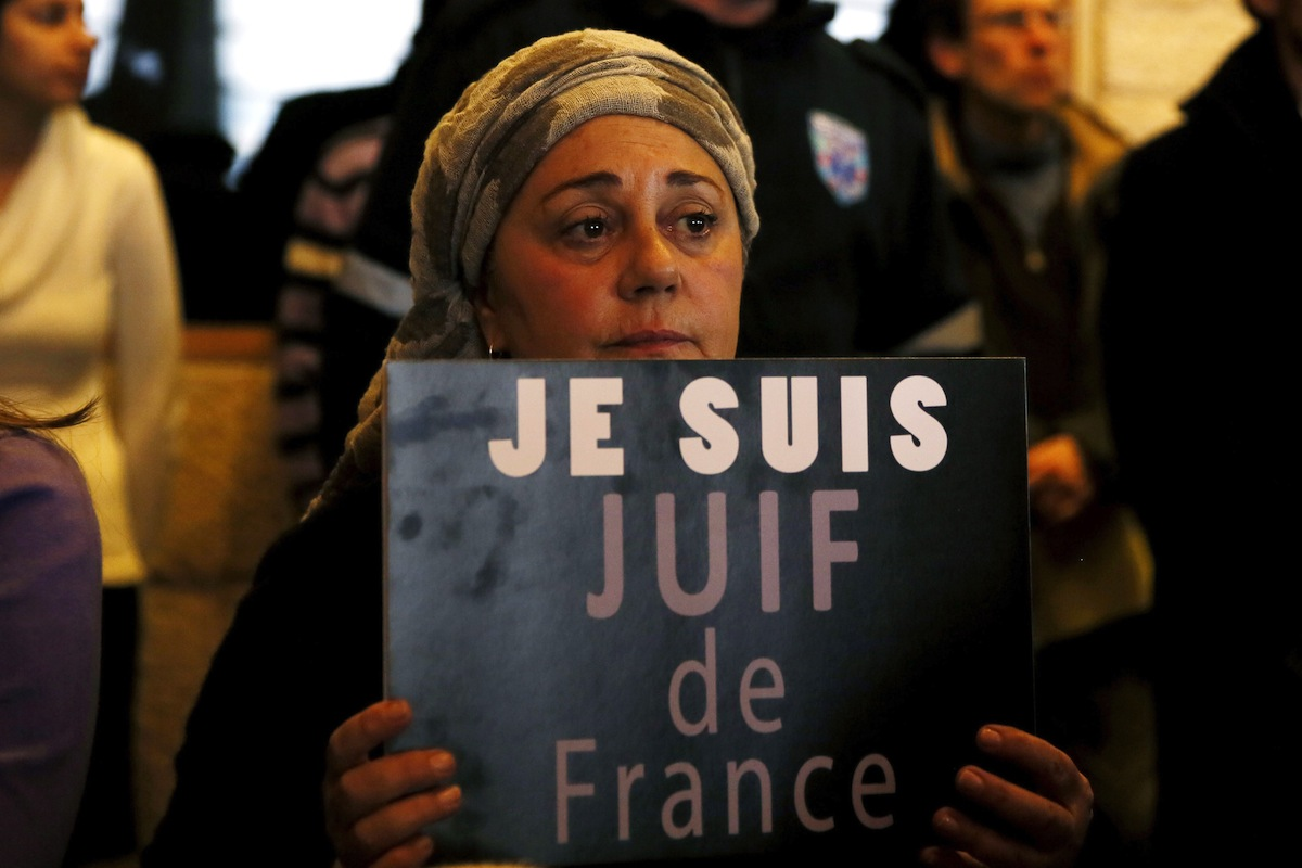 A member of the French Jewish community holds a sign during a rally in Jerusalem on Jan. 11, 2015, to demonstrate Jerusalem's support for France and the Jewish community there.