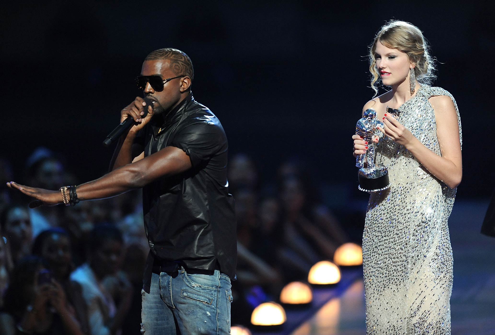 Kanye West takes the microphone from Taylor Swift and speaks onstage during the 2009 MTV Video Music Awards on Sept. 13, 2009