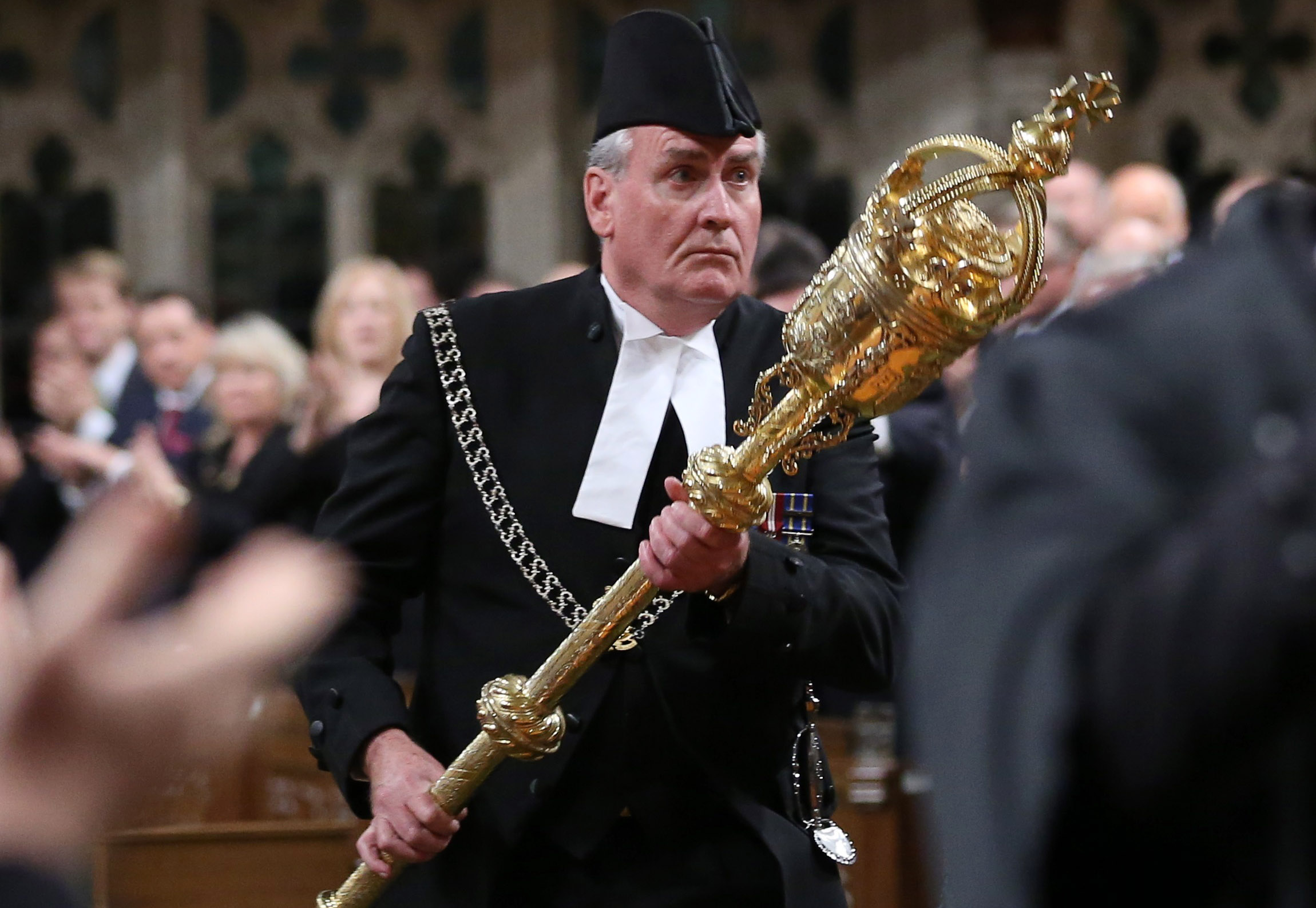 Sergeant-at-Arms Kevin Vickers is applauded in the House of Commons in Ottawa October 23, 2014.