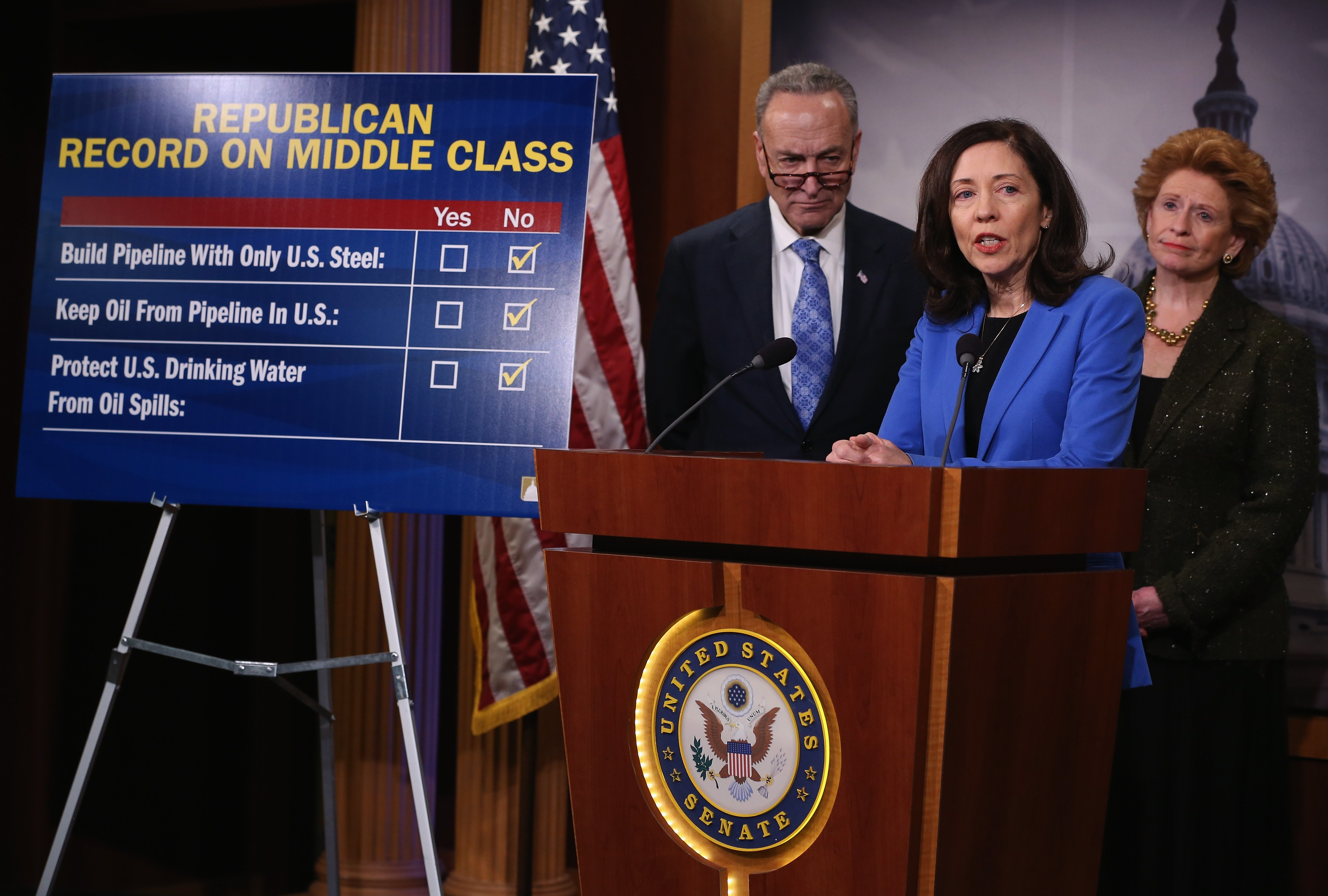 Sen. Maria Cantwell (D-WA) (C) speaks about the Keystone XL Pipeline while flanked by Sen. Chuck Schumer (D-NY) and Sen. Debbie Stabenow (D-MI) during a news conference on Jan. 29, 2015 at the US Capitol in Washington D.C.