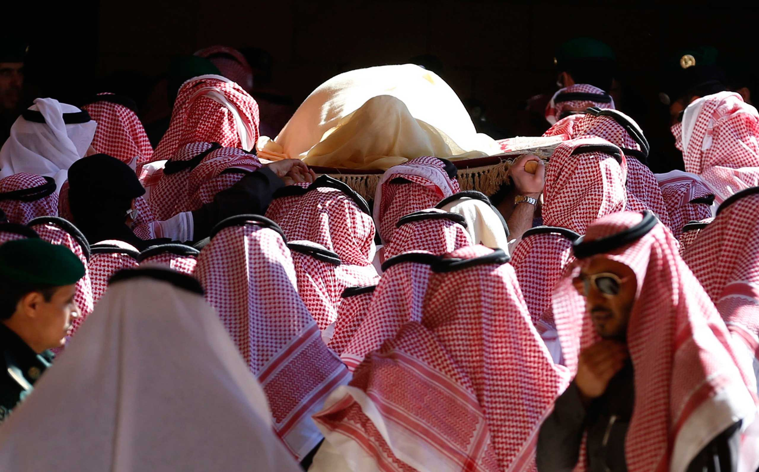 The body of Saudi King Abdullah bin Abdul Aziz is carried during his funeral at Imam Turki Bin Abdullah Grand Mosque, in Riyadh, Jan. 23, 2015.
