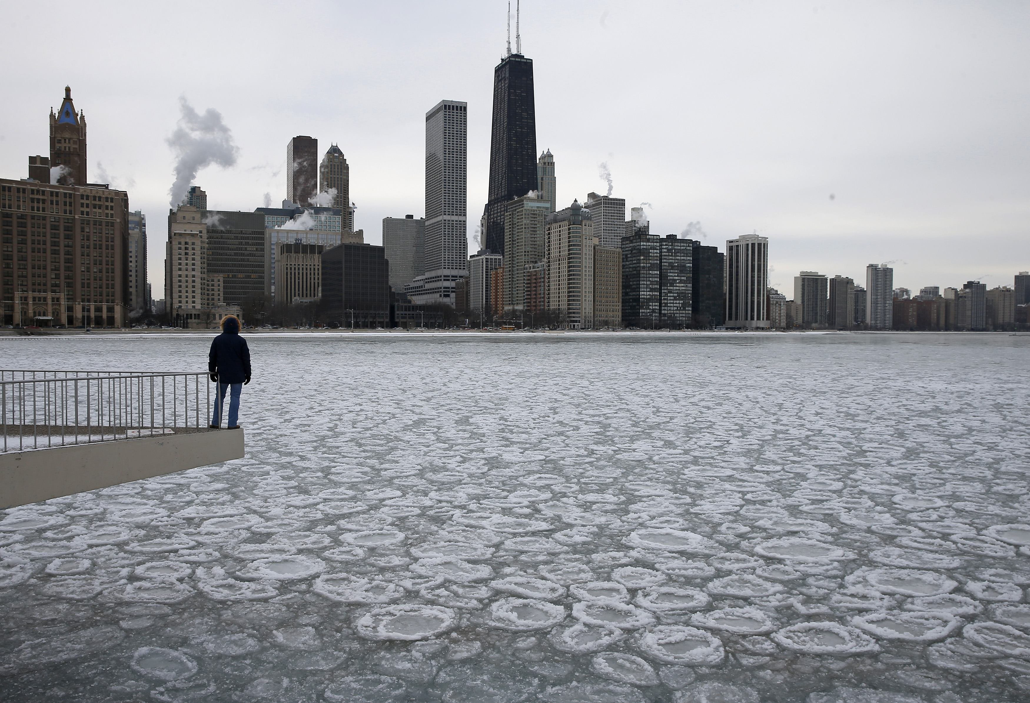 Charles Martinez looks over the partially frozen Lake Michigan and the Chicago skyline on Jan. 5, 2015.