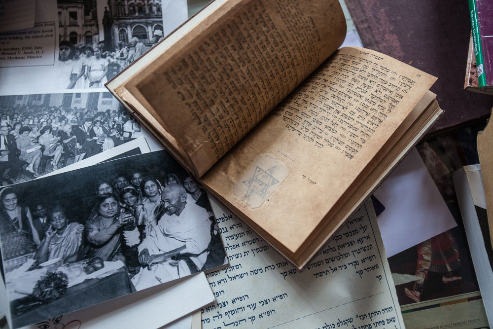 An old prayer book and photographs of the community in its heyday, one of them featuring Mahatma Gandhi at Flower Silliman's home.