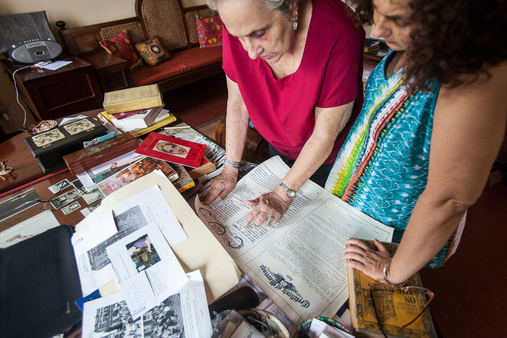 Jael Siliman (right), 58, is a former women's studies professor at the University of Iowa and is compiling a digital archive that will preserve documents, photographs and other memorabilia from the community. She is pictured here with her mother, Flower, as they examine an old marriage certificate in August 2014.