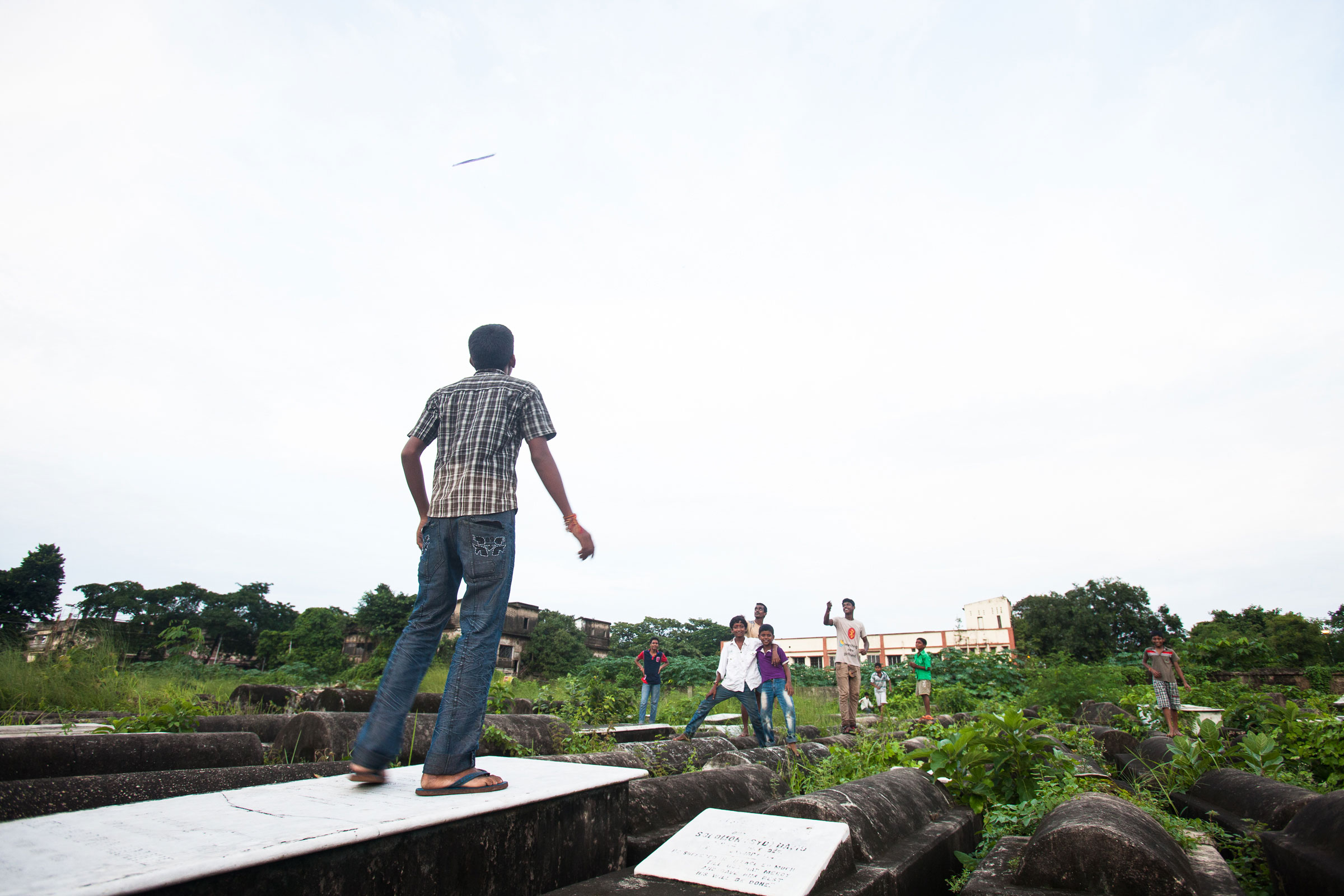 A few locals come to the grounds of the cemetery to fly kites in August 2013.