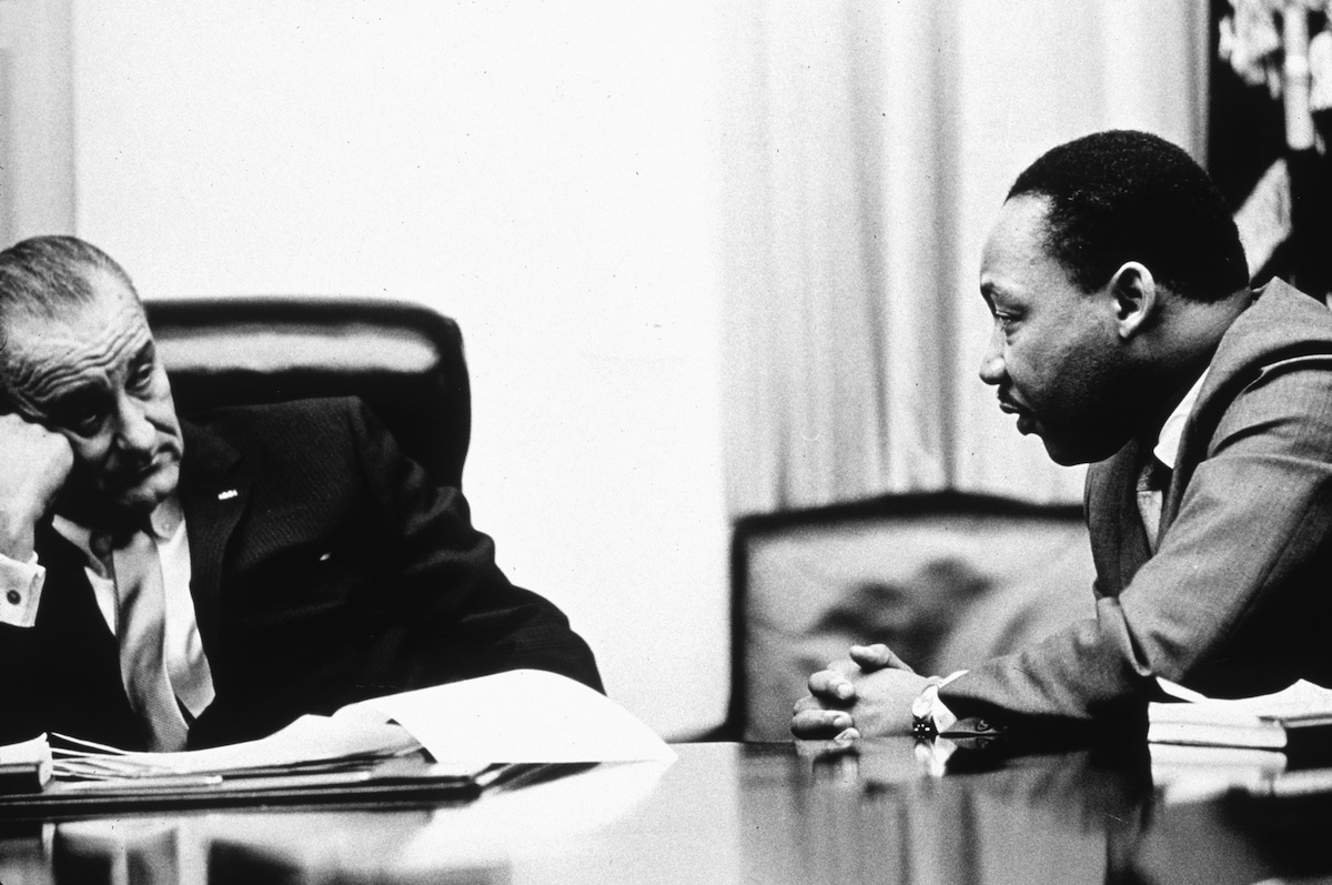 President Lyndon B Johnson (1908 - 1973) discusses the Voting Rights Act with civil rights campaigner Martin Luther King Jr. (1929 - 1968) in 1965