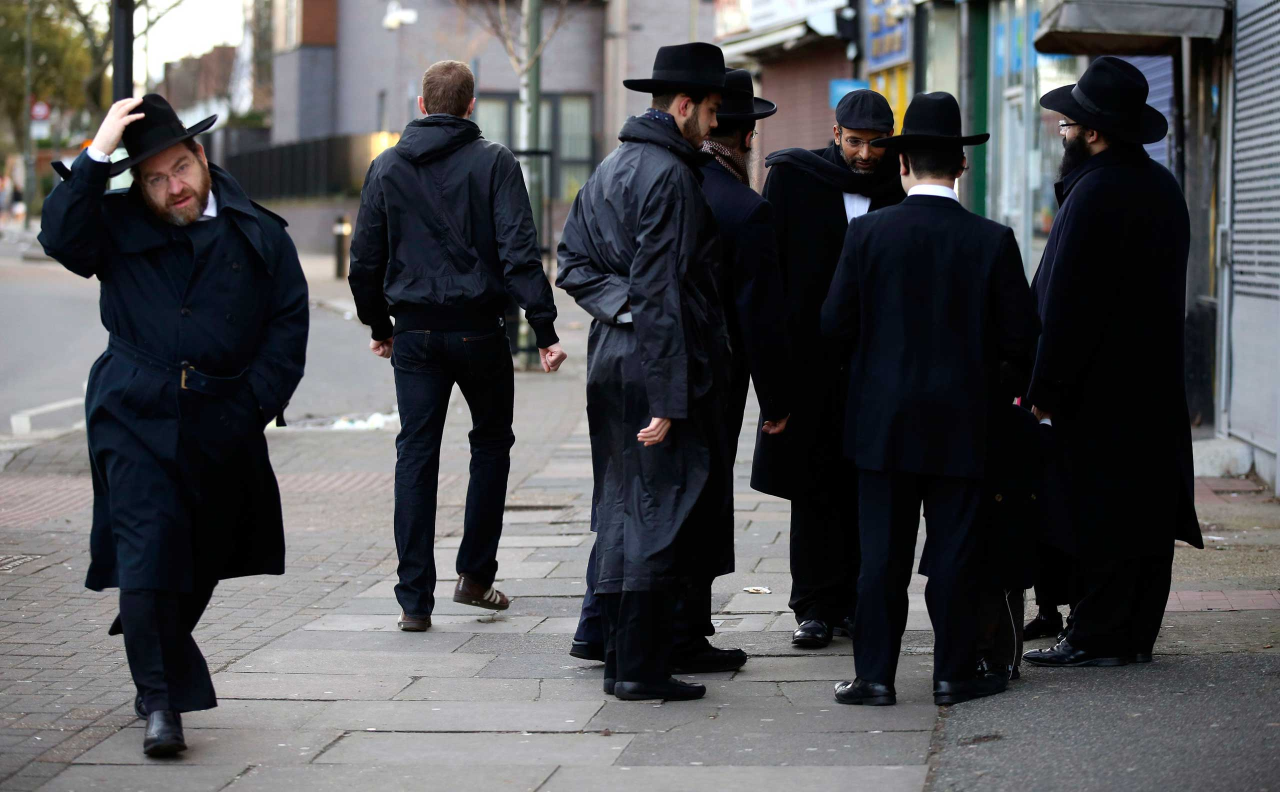 Jewish men talk in Golders Green, London, Jan. 10, 2015.